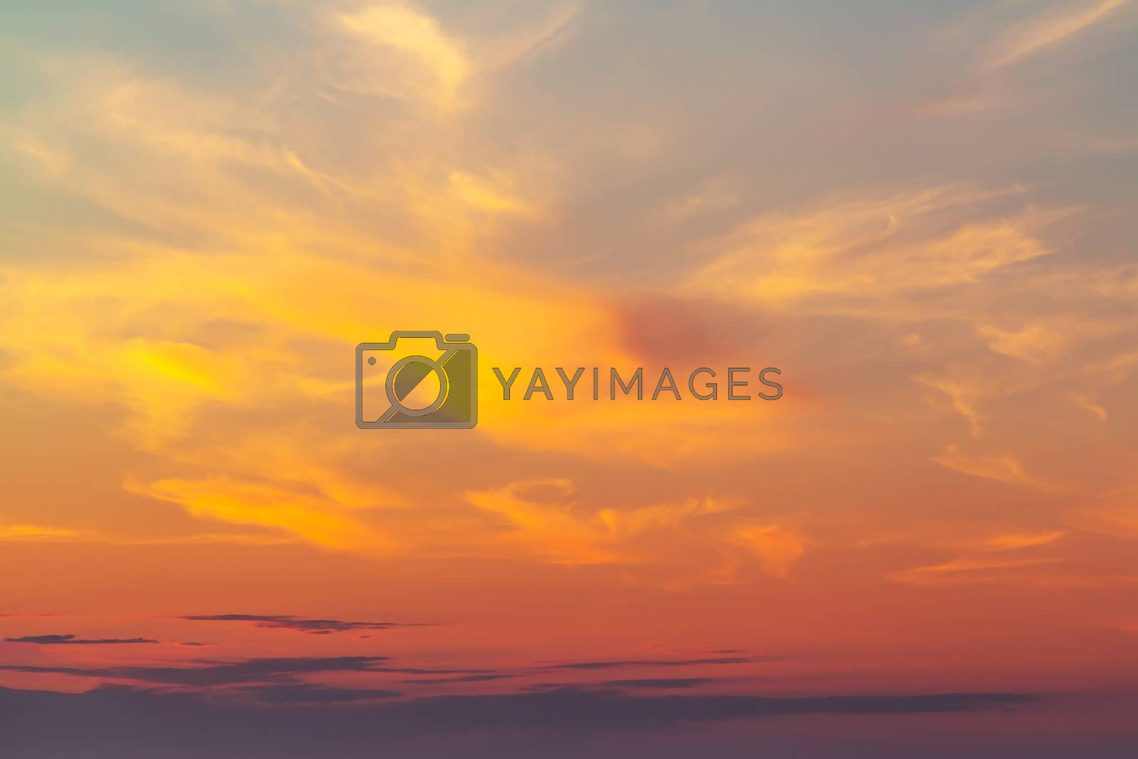 sky during a colorful, bright orange sunset by galsand