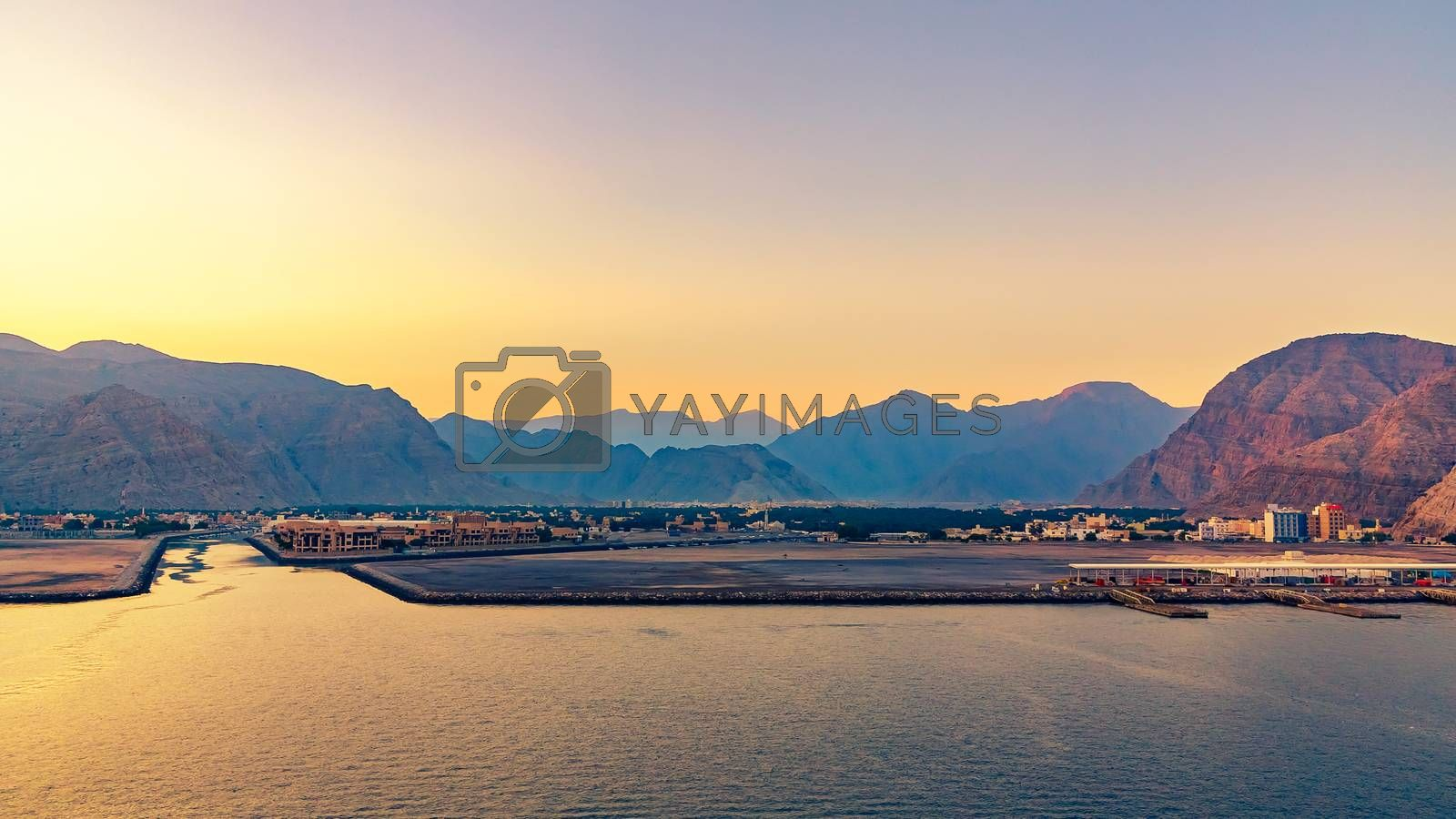 Sea coast of the Gulf of Oman, a small settlement or a town away on the shore by galsand
