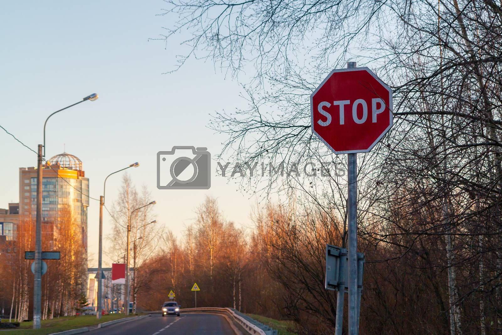 Stop sign on the side of the road at the entrance to the city by galsand