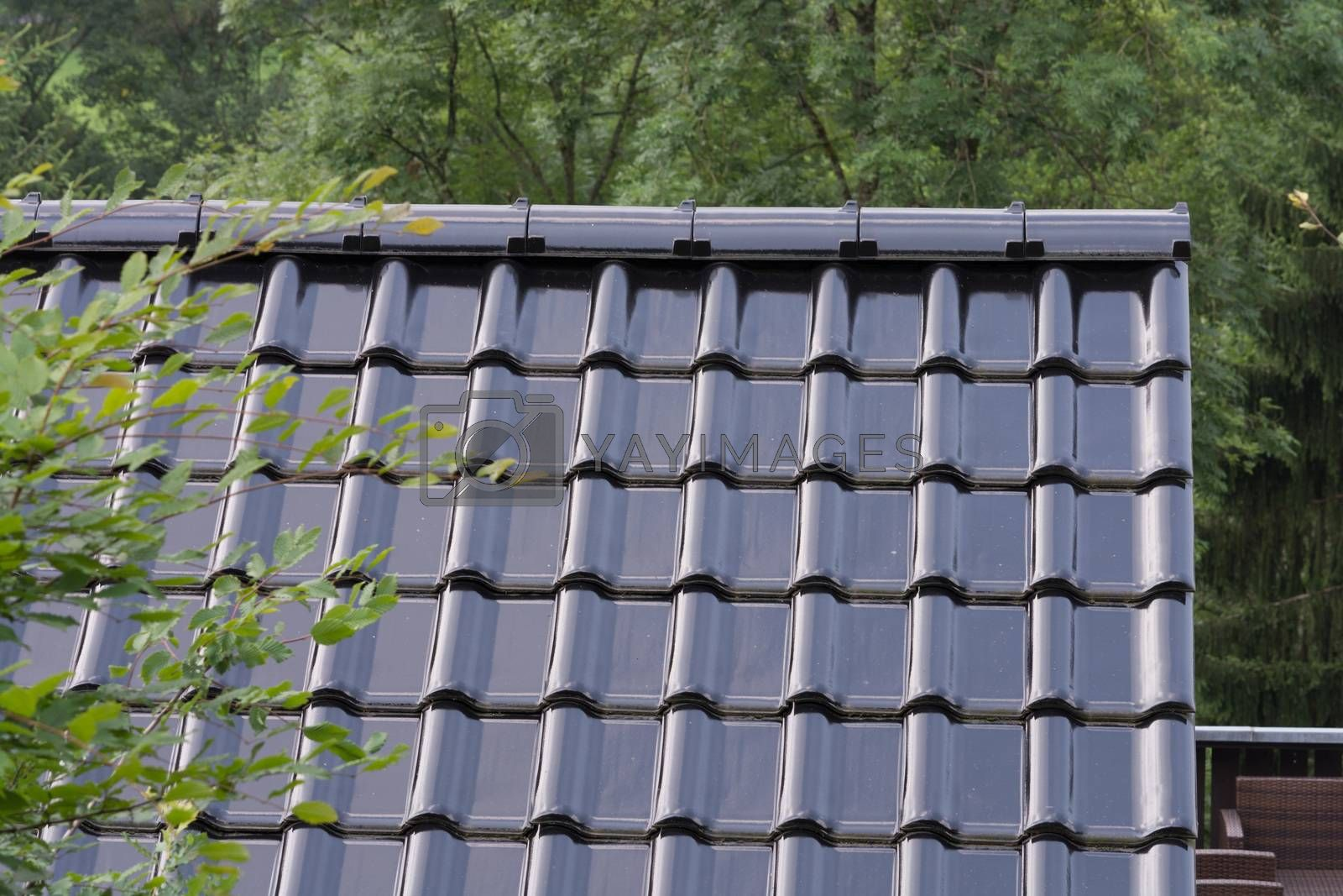 Black roof tiles on a roof             by JFsPic