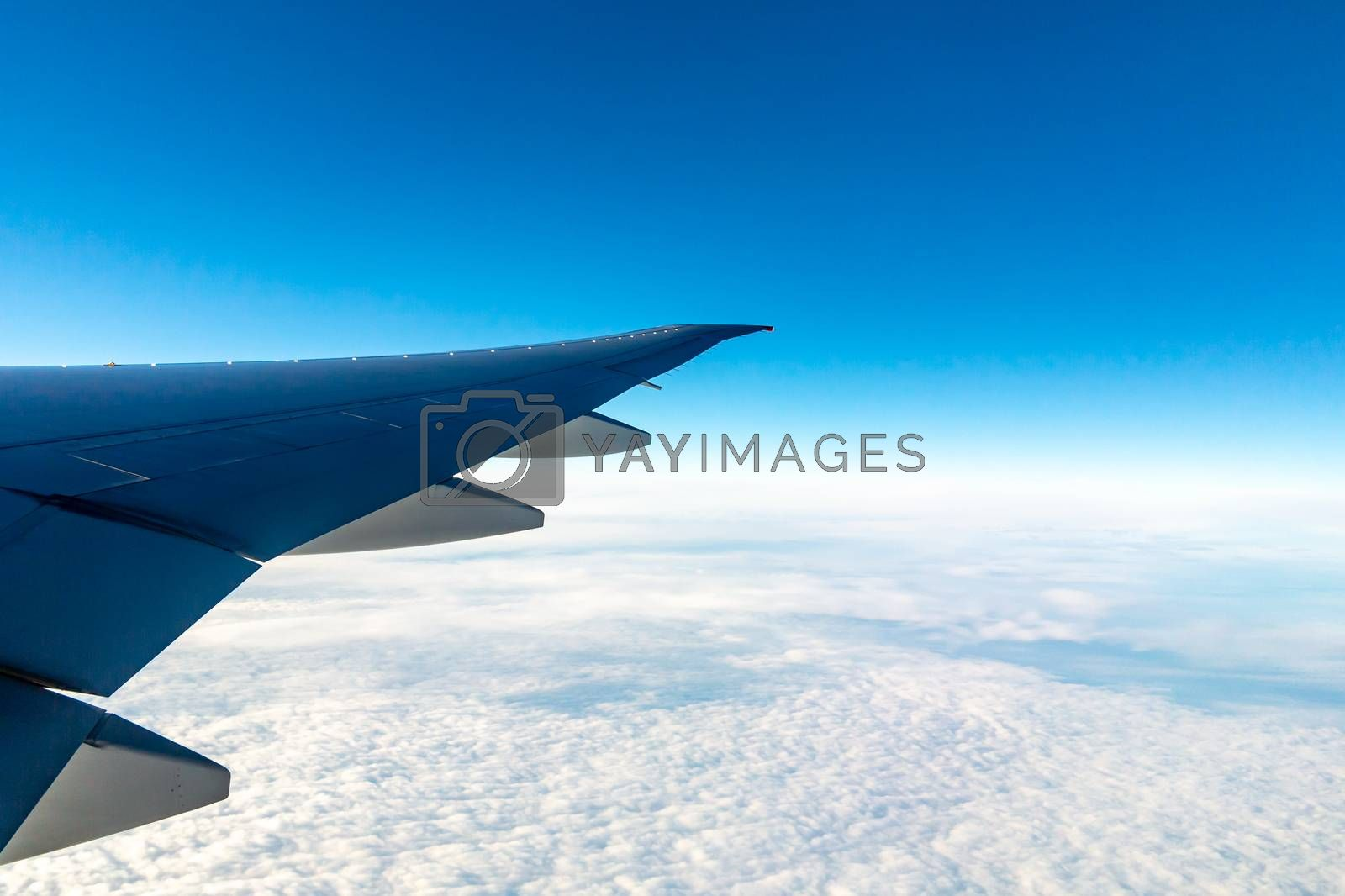 Clouds under the wing of an airplane. Amazing view from the window of the airplane during the flight by galsand