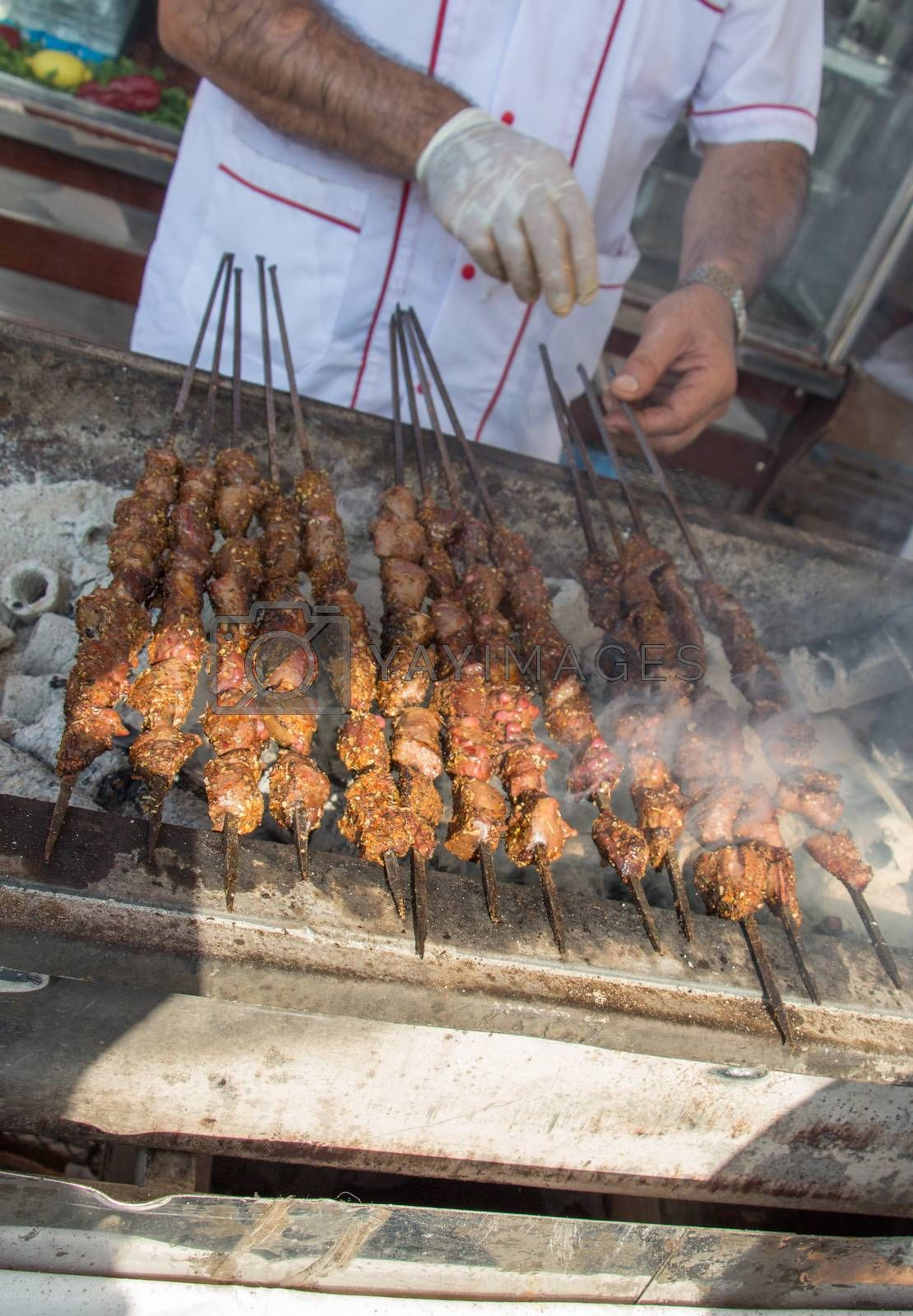 Turkish style meat shashlyk being grilled on grill