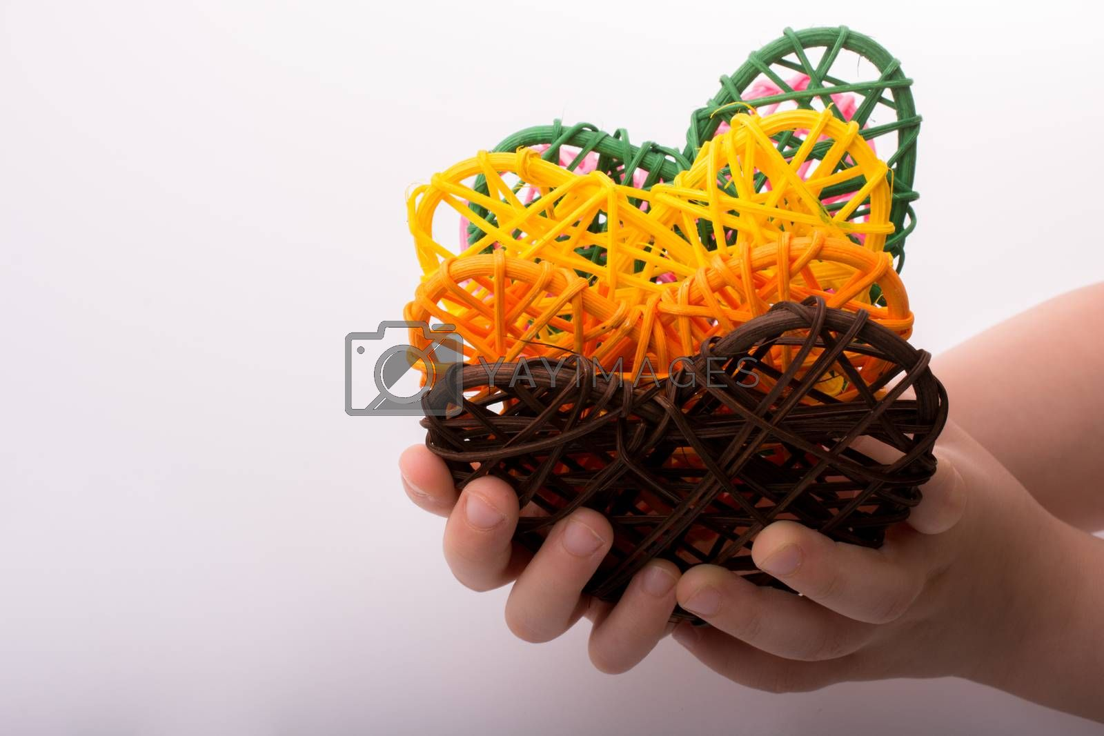 Handmade straw heart or valentines day object in hand