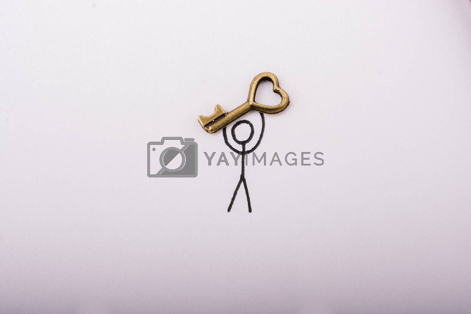 Man carrying a  heart shaped key  on white background