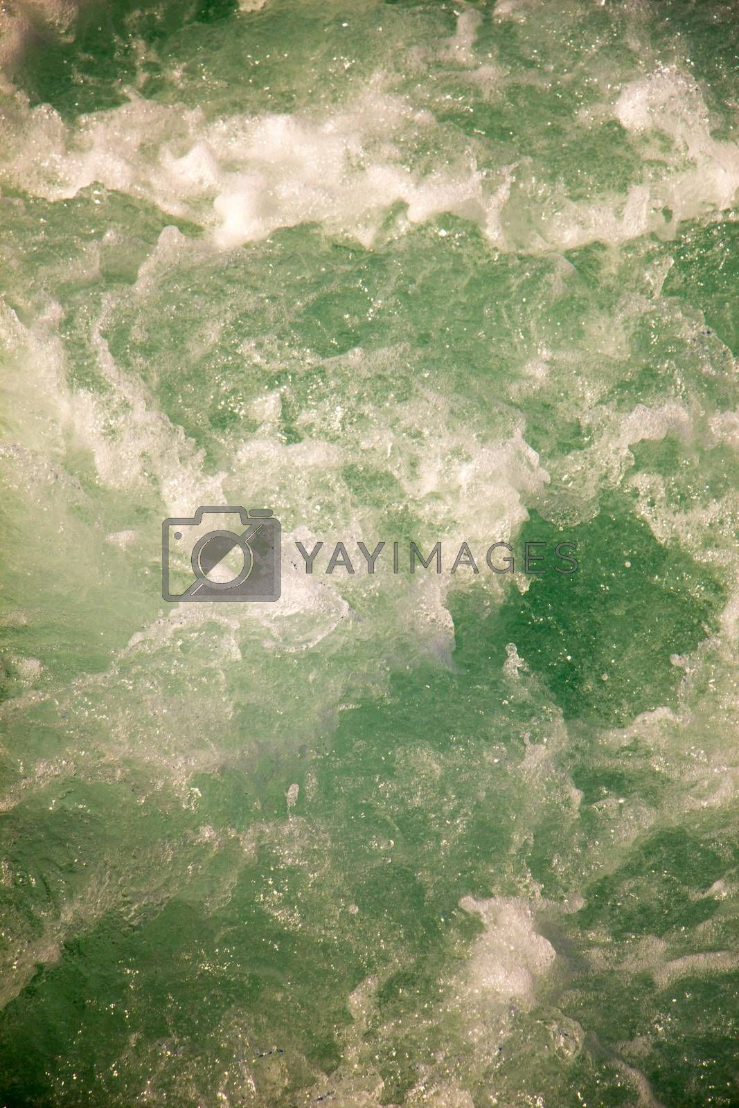 Water surface background with foam and bubbles by berkay