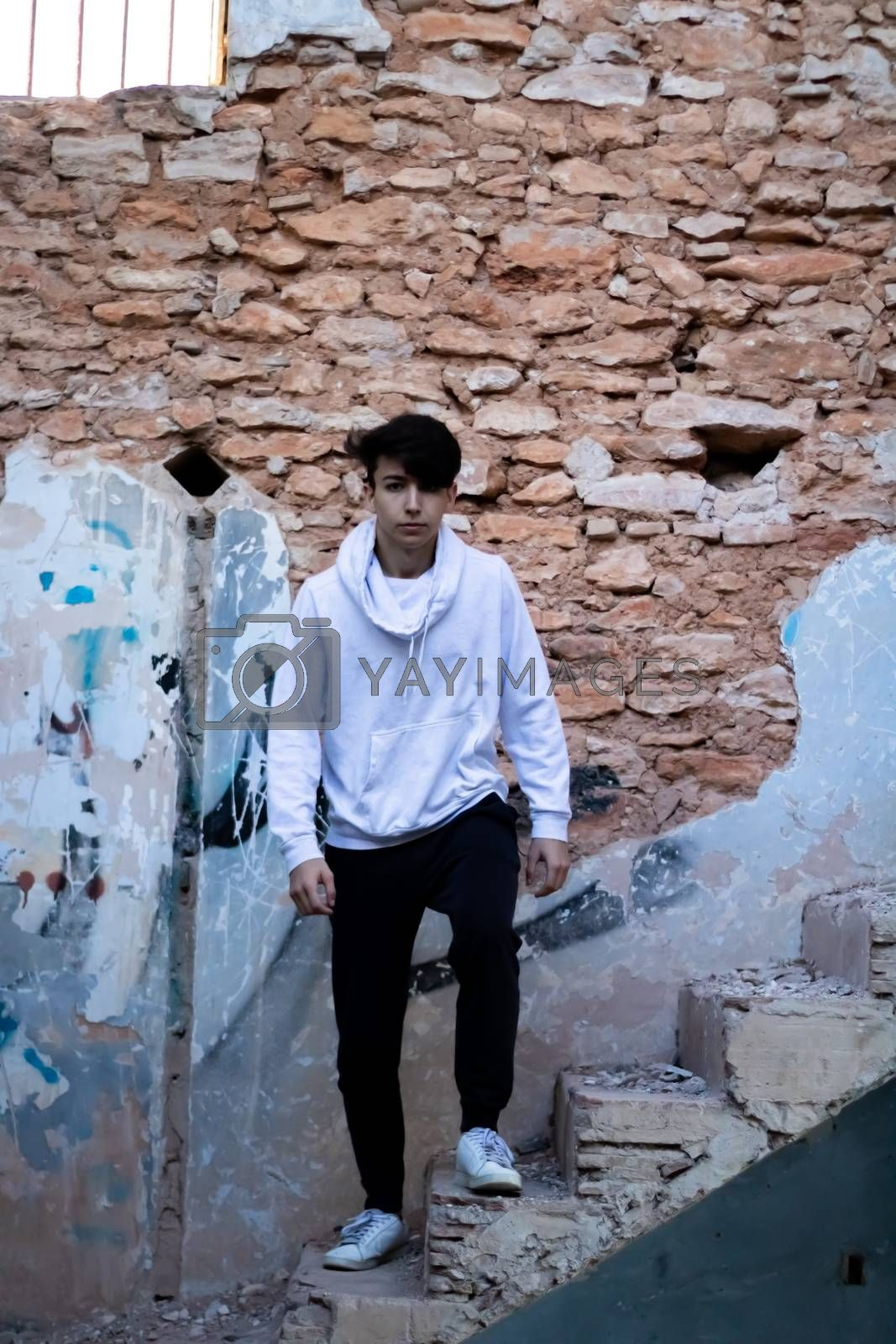Young boy posing in abandoned house