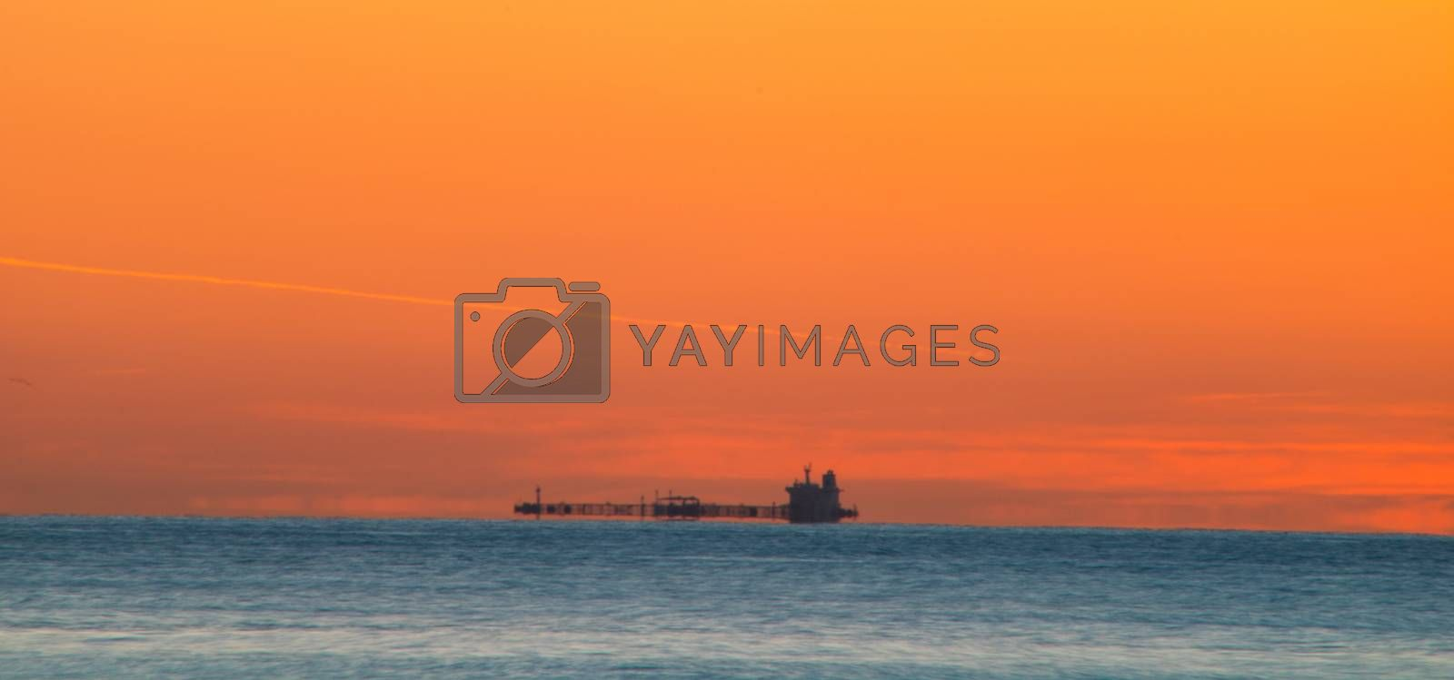 Freighter sailing at dawn by Barriolo82