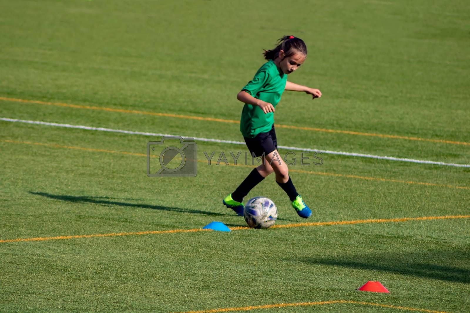 Little girl in a soccer training in Burriana