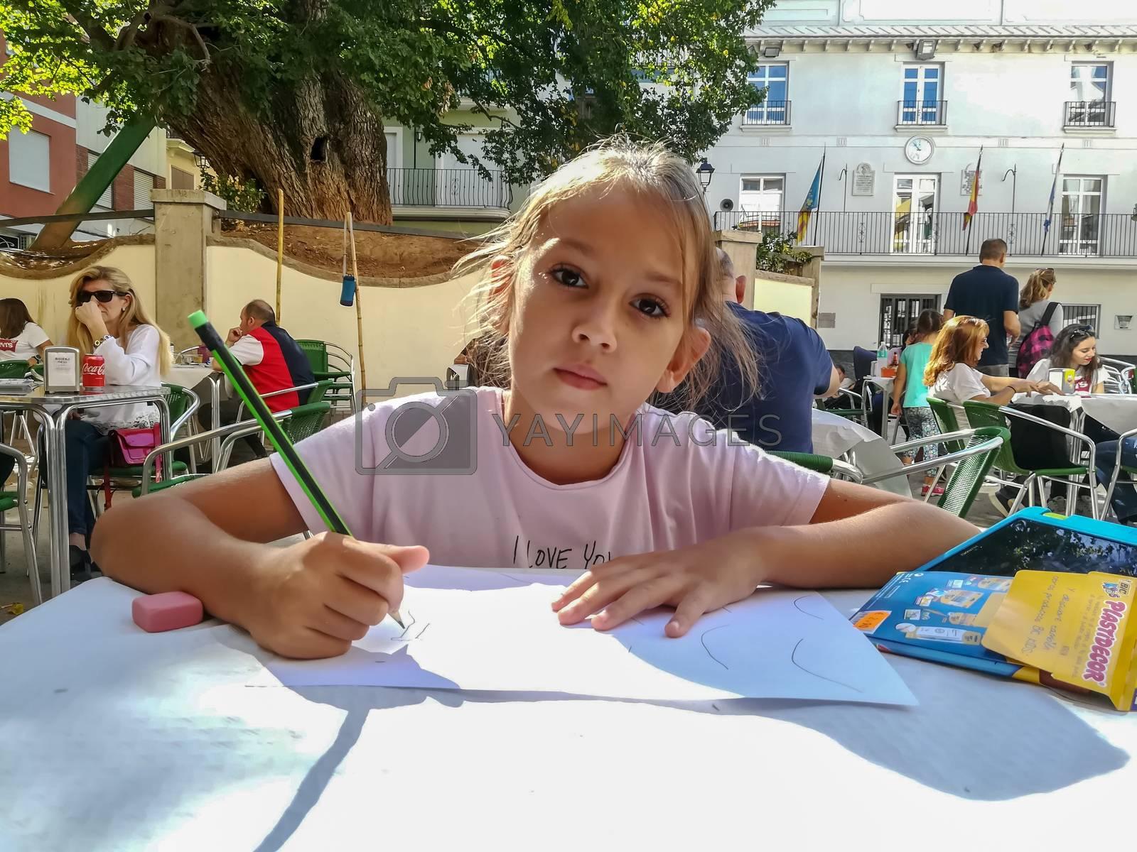Navajas, Spain 10/12/2018: Little girl drawing by Barriolo82