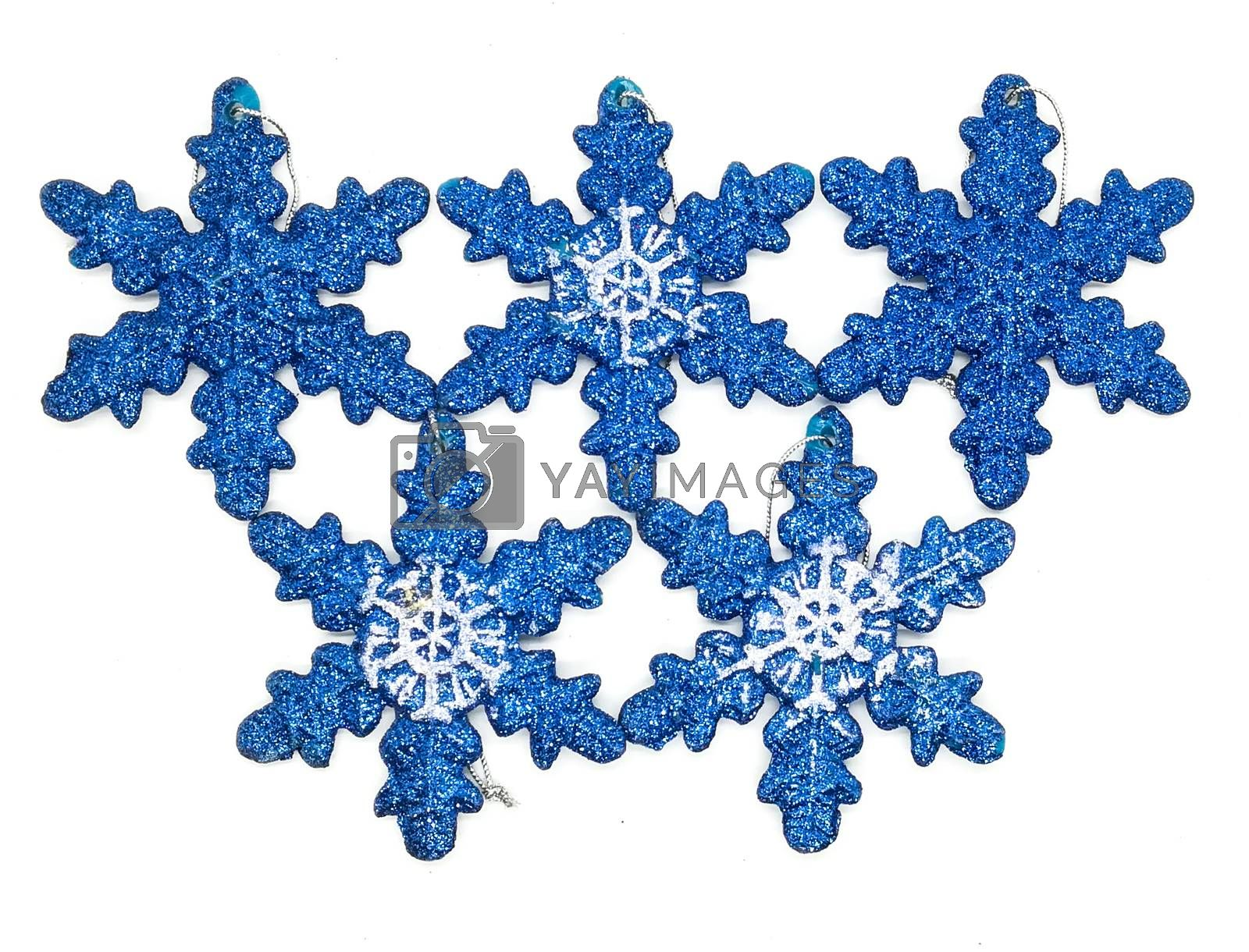 Blue christmas decorations in composition on white background