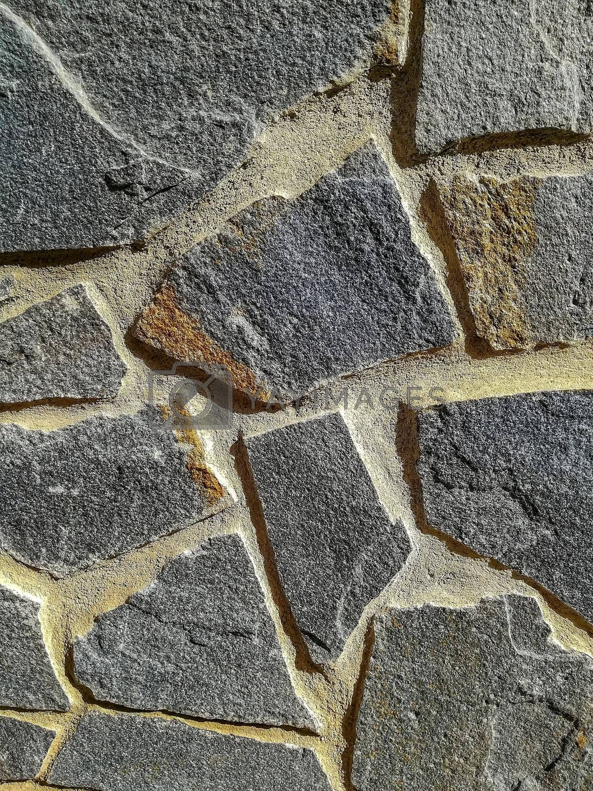 Facade of natural stone and gray cement