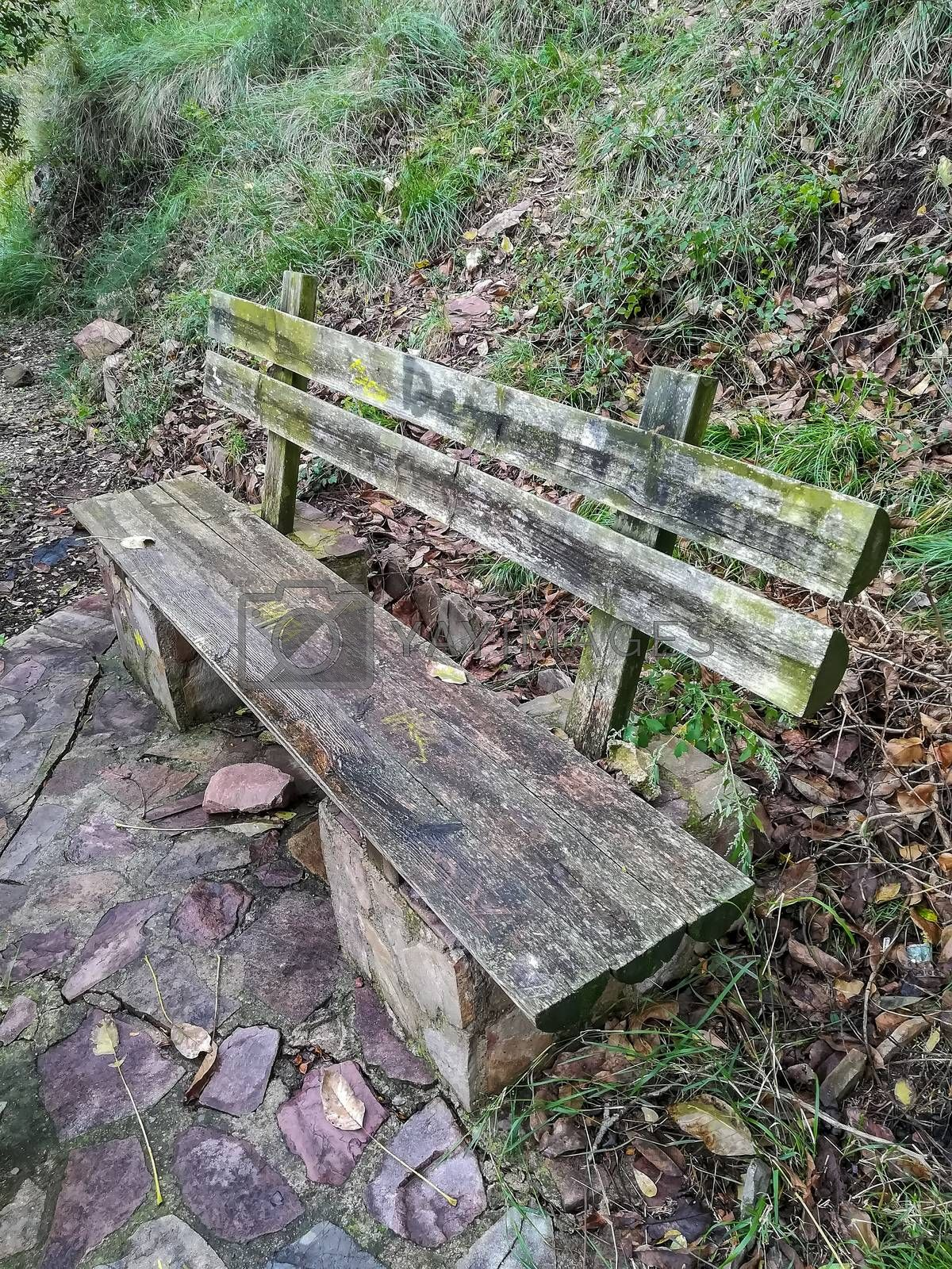 Old stone and wood bench in the mountain