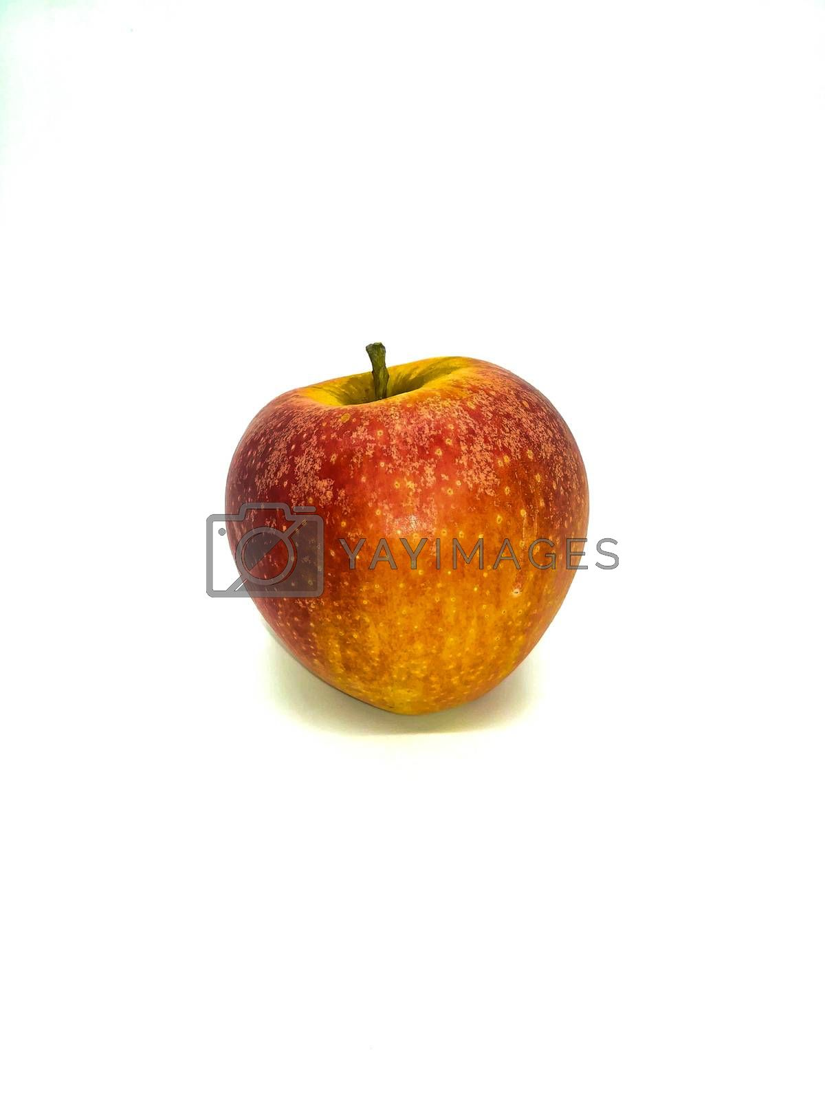 Red apple with yellow speckles on white background