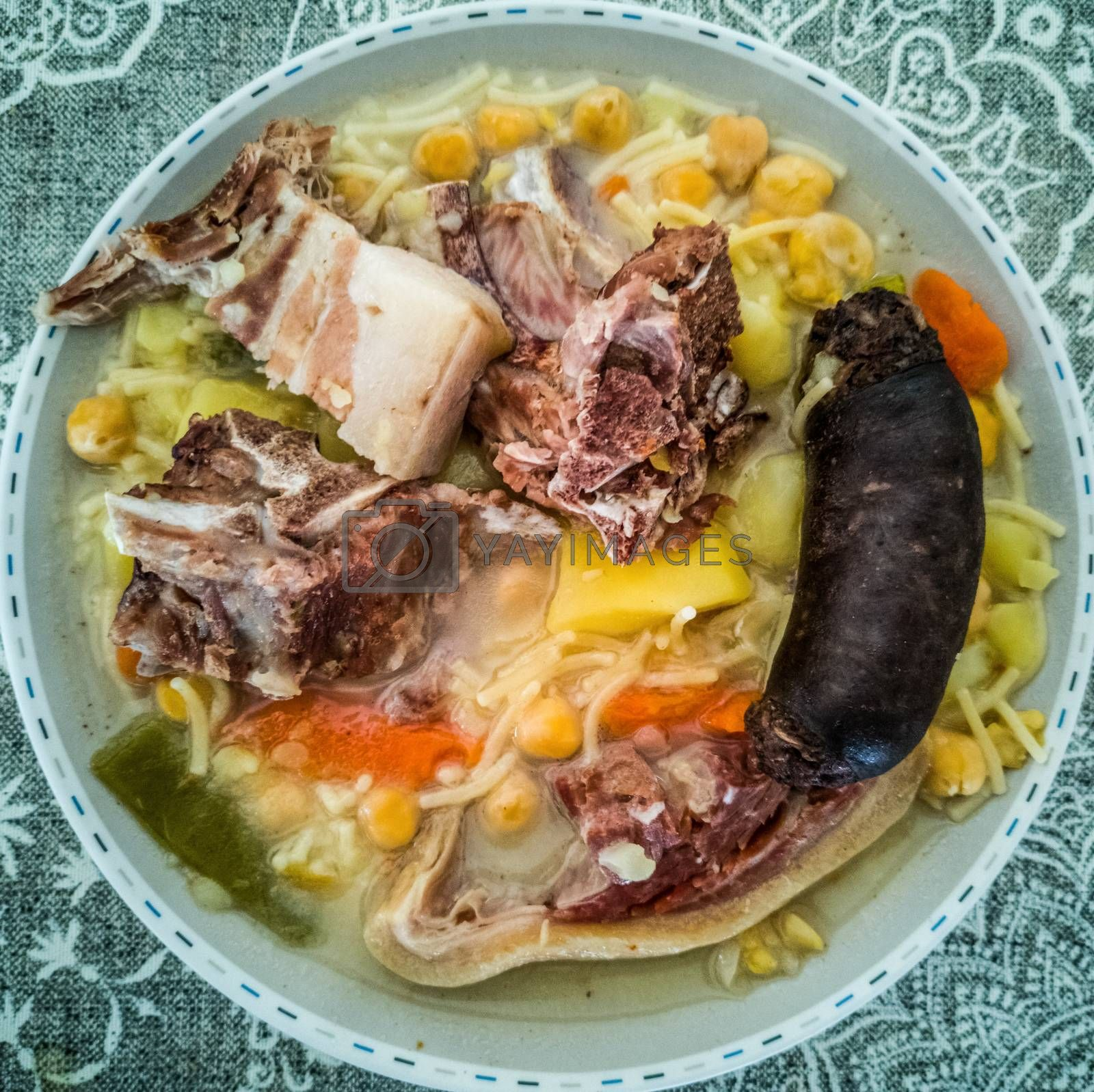 View of typical spanish food with meat and blood sausage