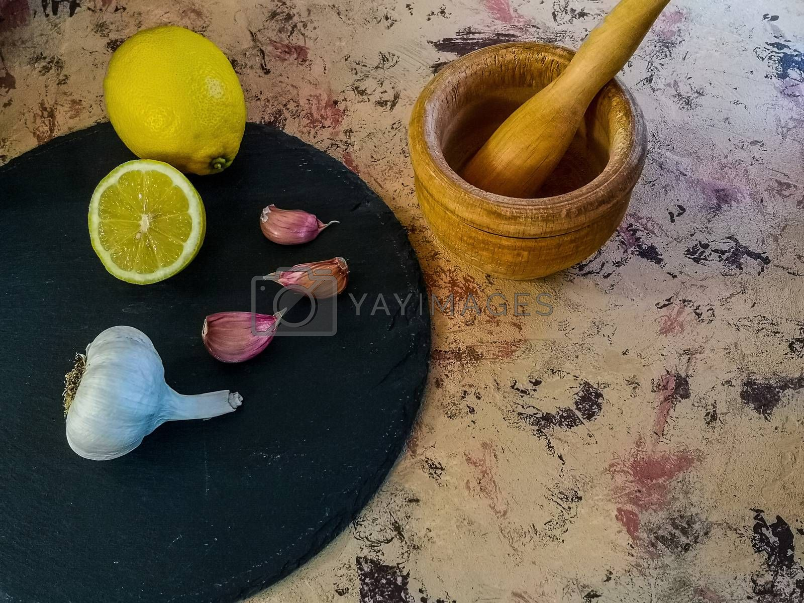 Ingredients and utensils to make mayonnaise with garlic in composition on light background