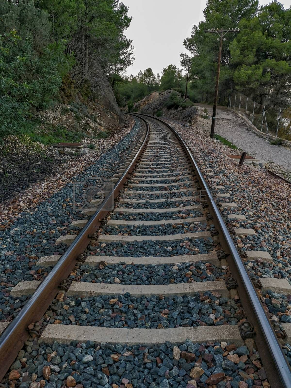 Train track through the mountain with a curve