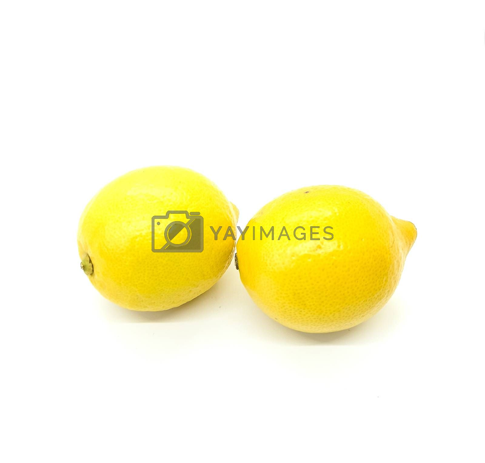 Two lemons in composition on white background