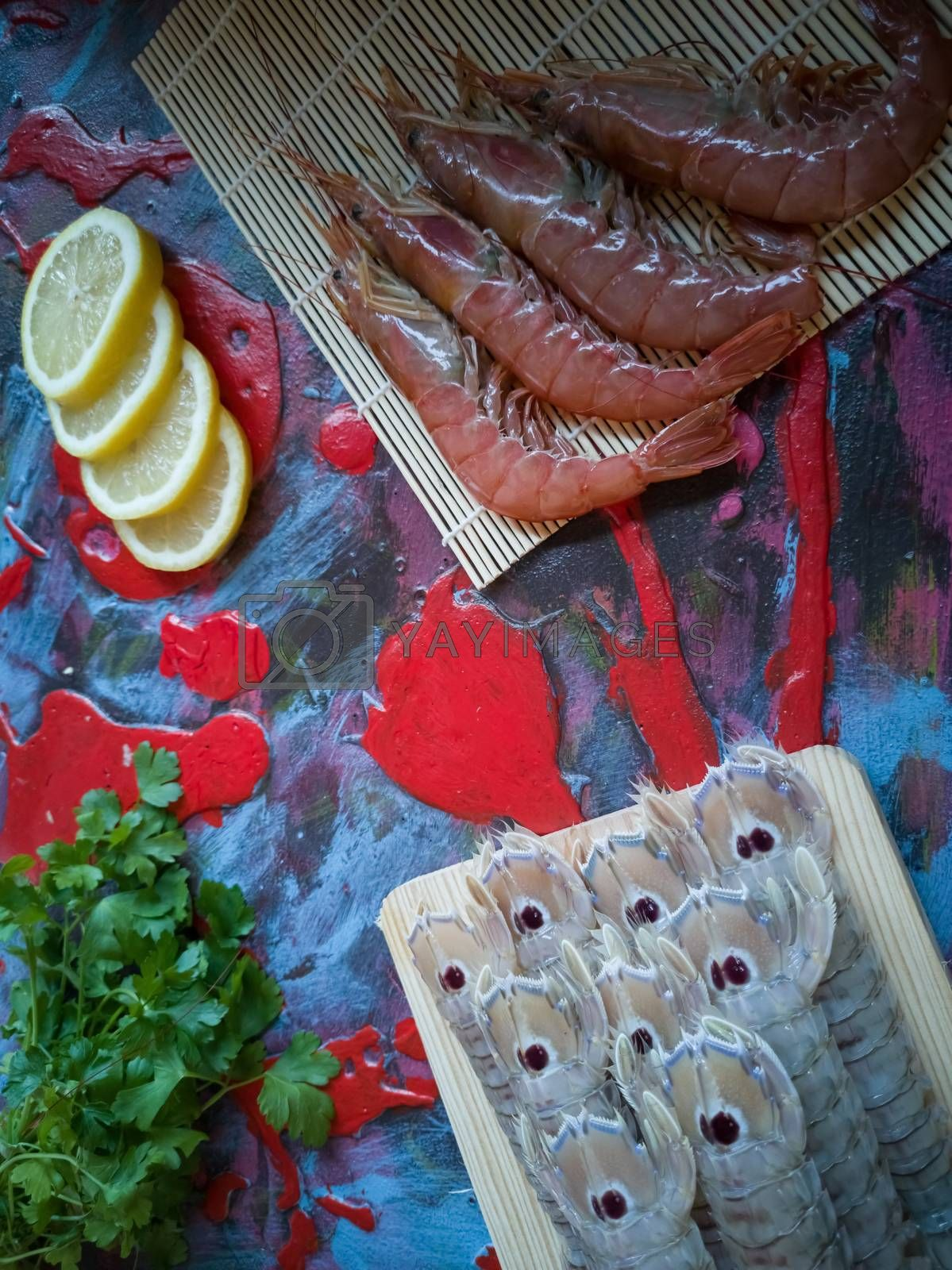 Seafood in composition on colorful and rough background