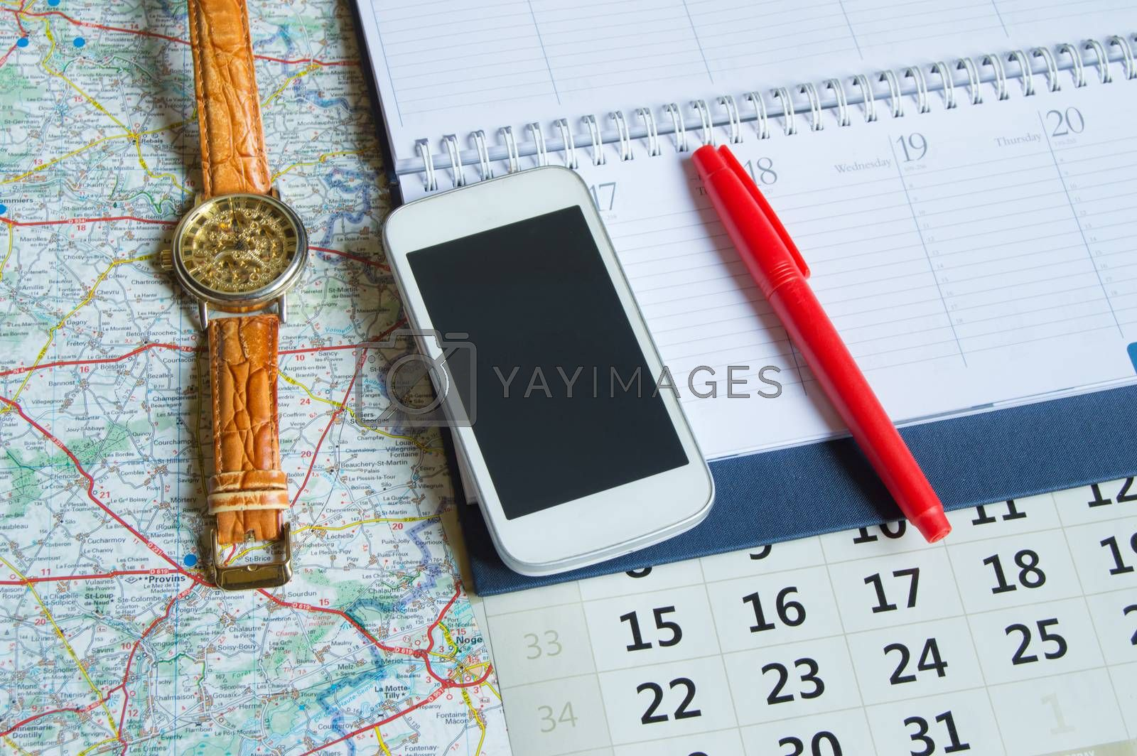 Diary and a calendar with hours, map, travel concept trip copy space.