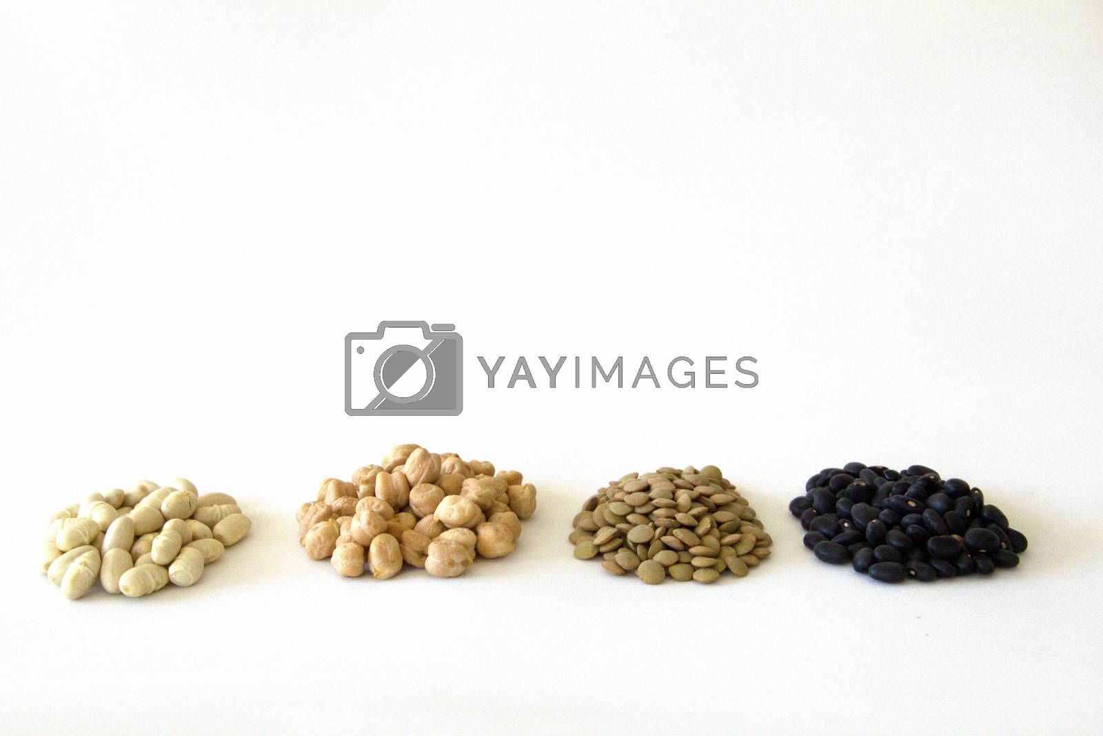piles of White beans, peas, lentils and black beans with white blackground