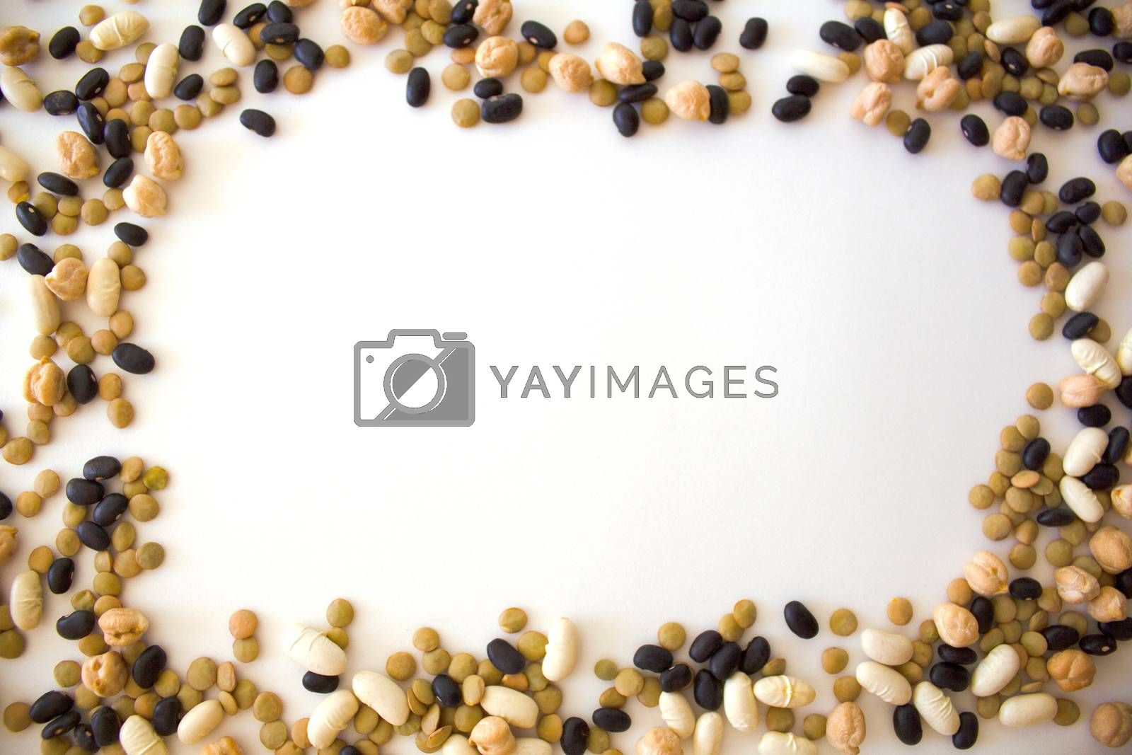 white beans, black beans, peas and lentils arranged in frame form