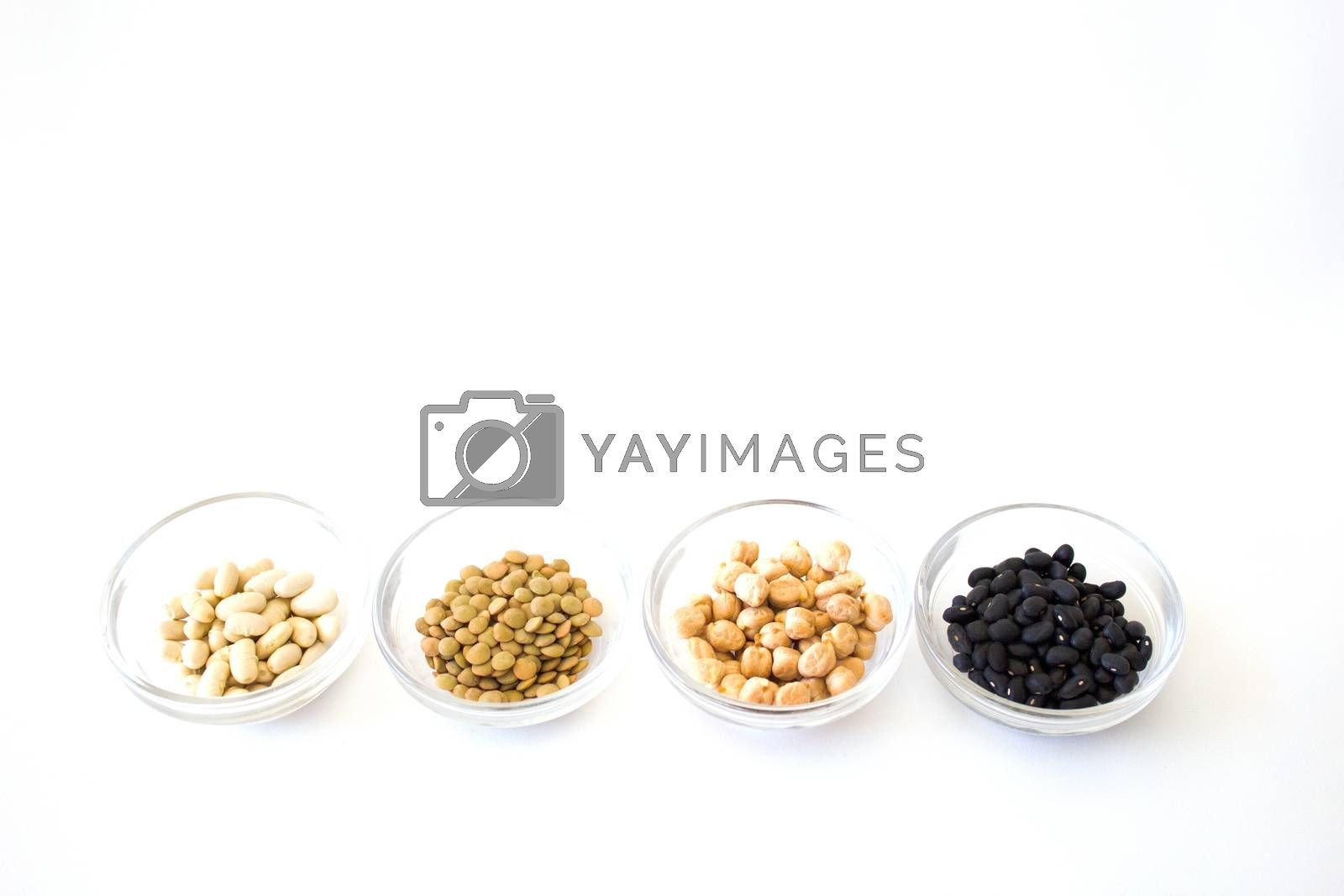four bowls with white beans, lentils, peas and black beans