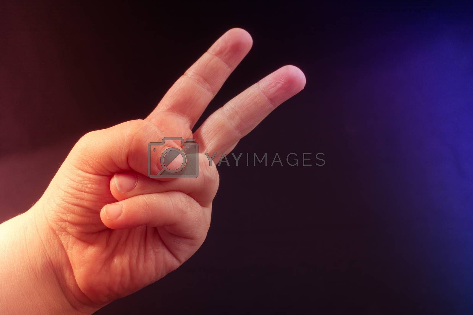 The sign of victory and peace in black background