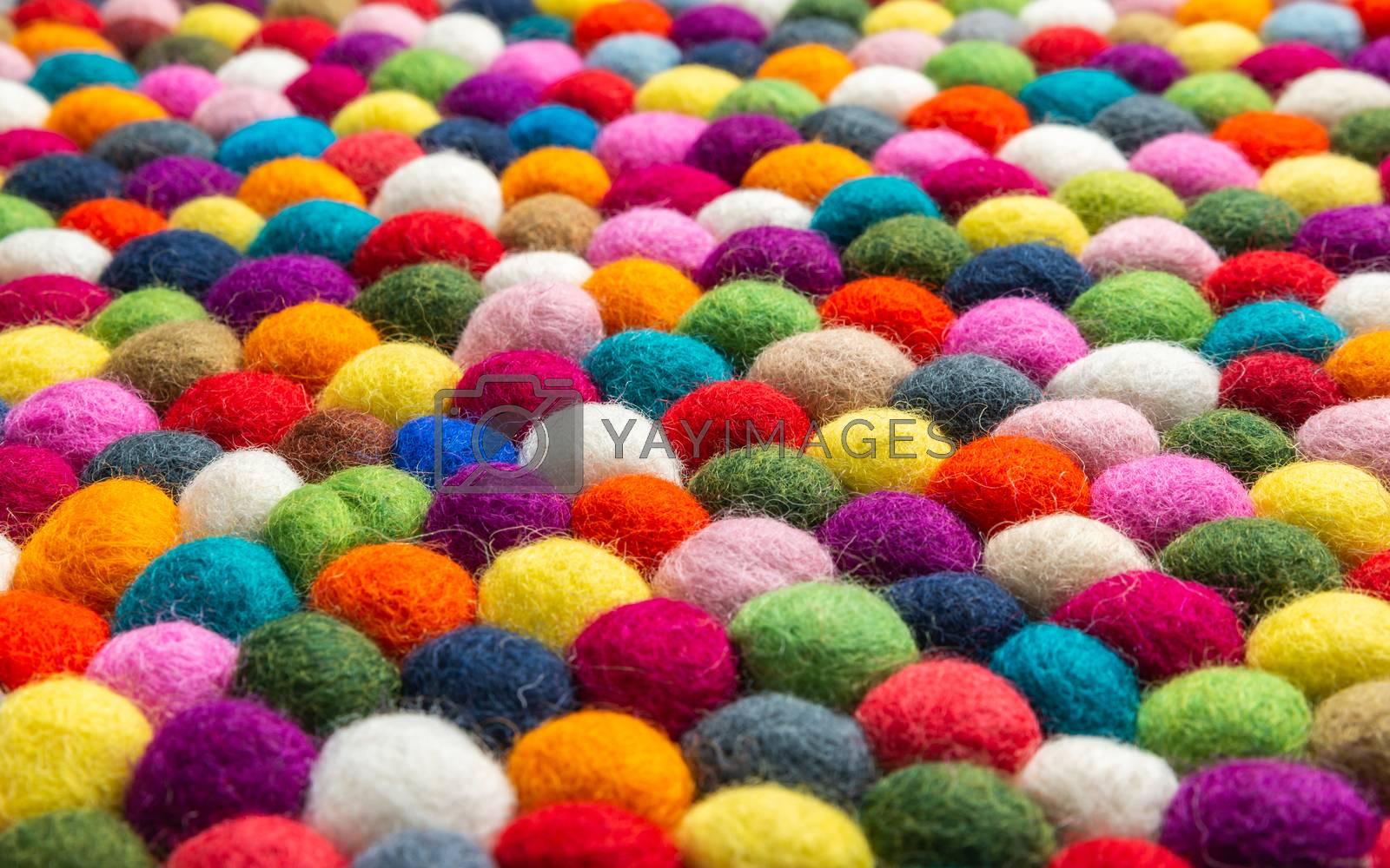 Multicolored felt ball rug detail by Thomas Dutour