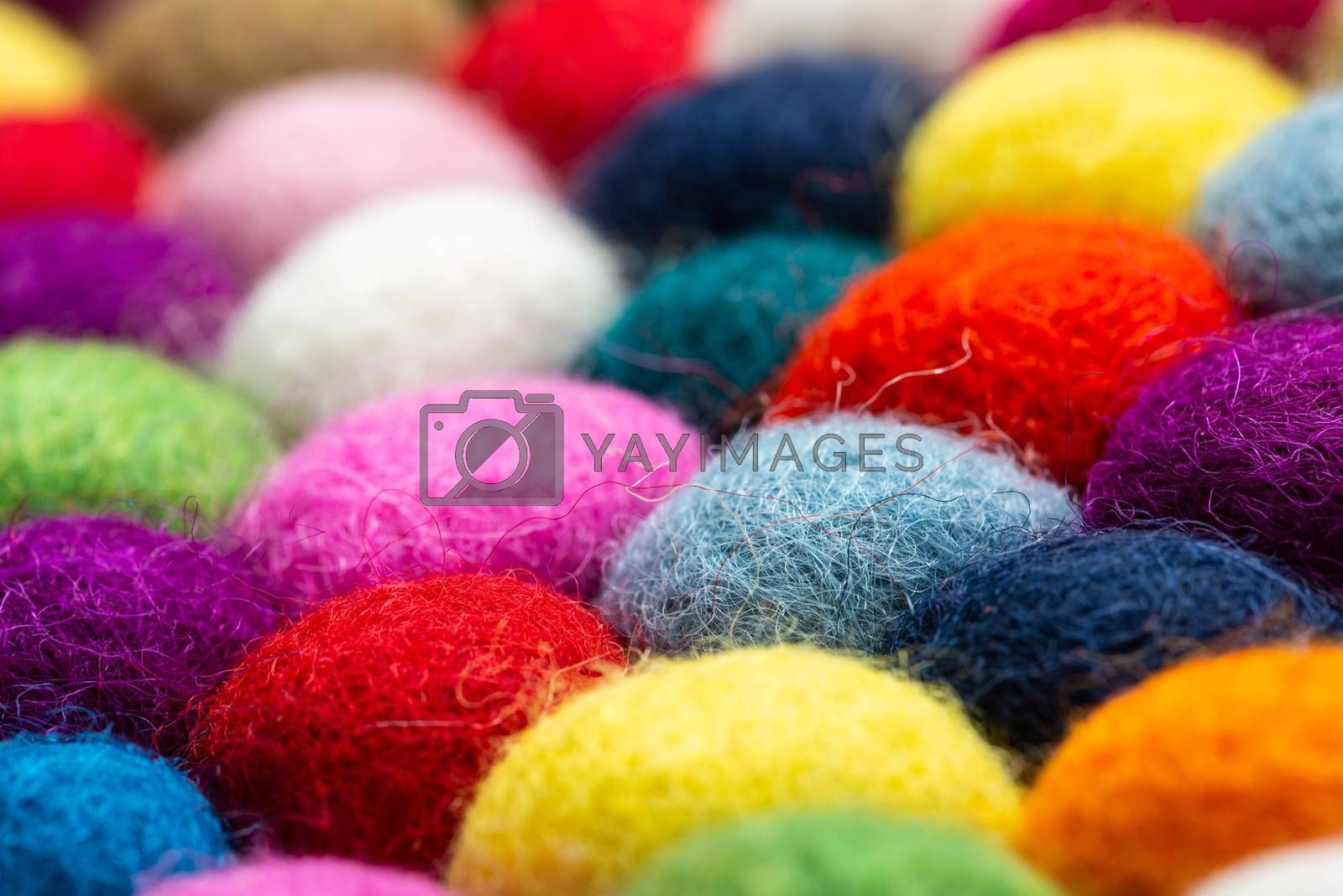 Multicolored felt ball rug detail, colorful texture
