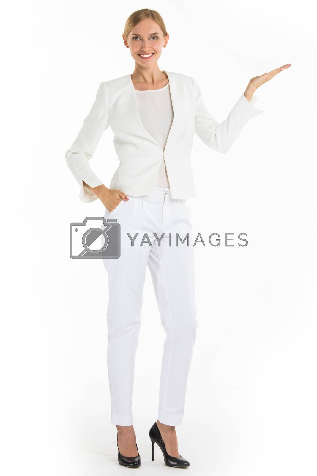 Businesswoman pointing with hand palm at empty copy space, studio isolated on white background, full length portrait