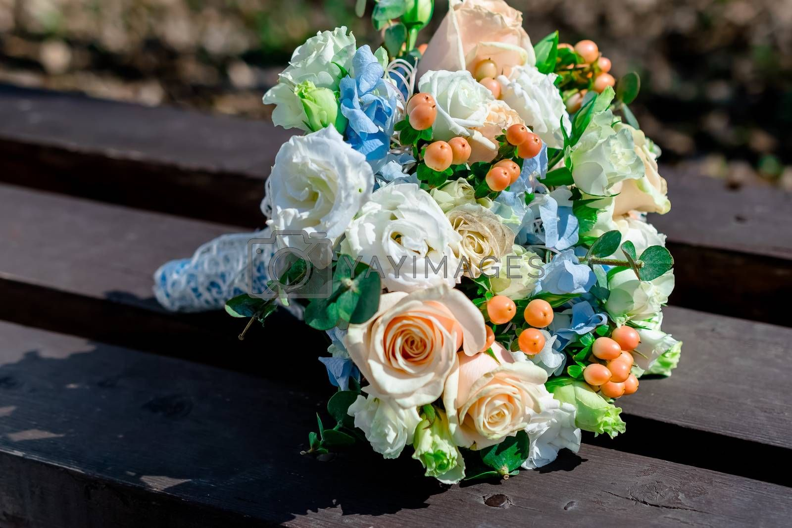bride's bouquet lies on the bench