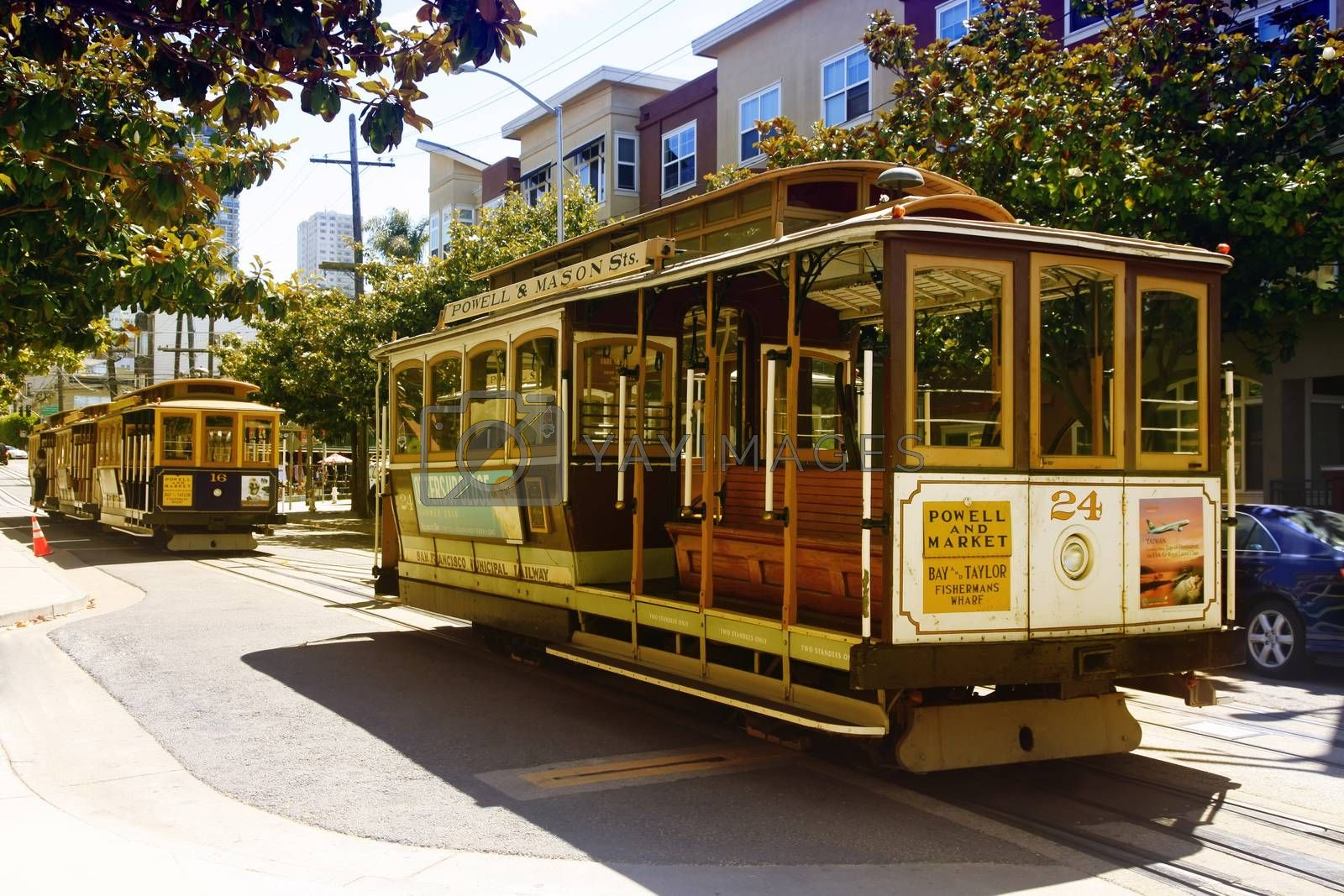 SAN FRANCISCO, CA, USA - AUGUST 17, 2013: Passengers ride in a cable car on August 17, 2013 in San Francisco. It is the most popular way to get around the City of San Fransisco which is in service since 1873.