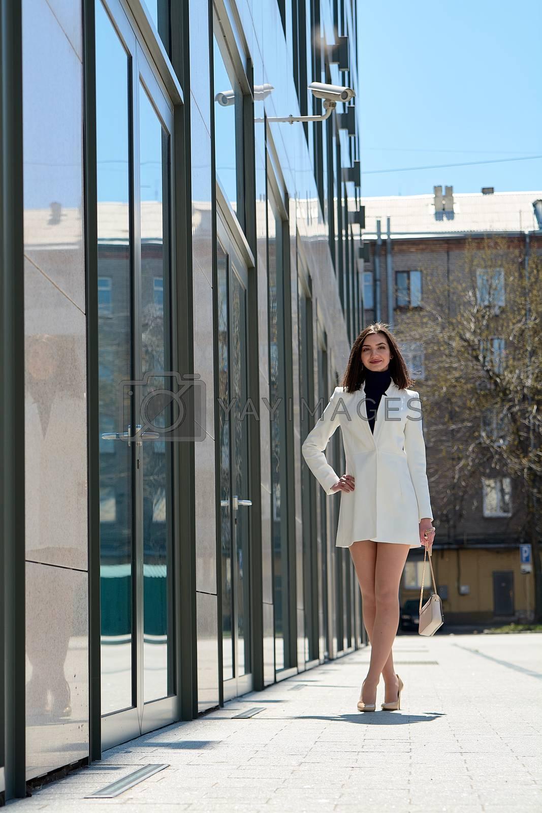 Beautiful brunette woman. Modern urban woman portrait. Fashion business style clothes. by nixrenas