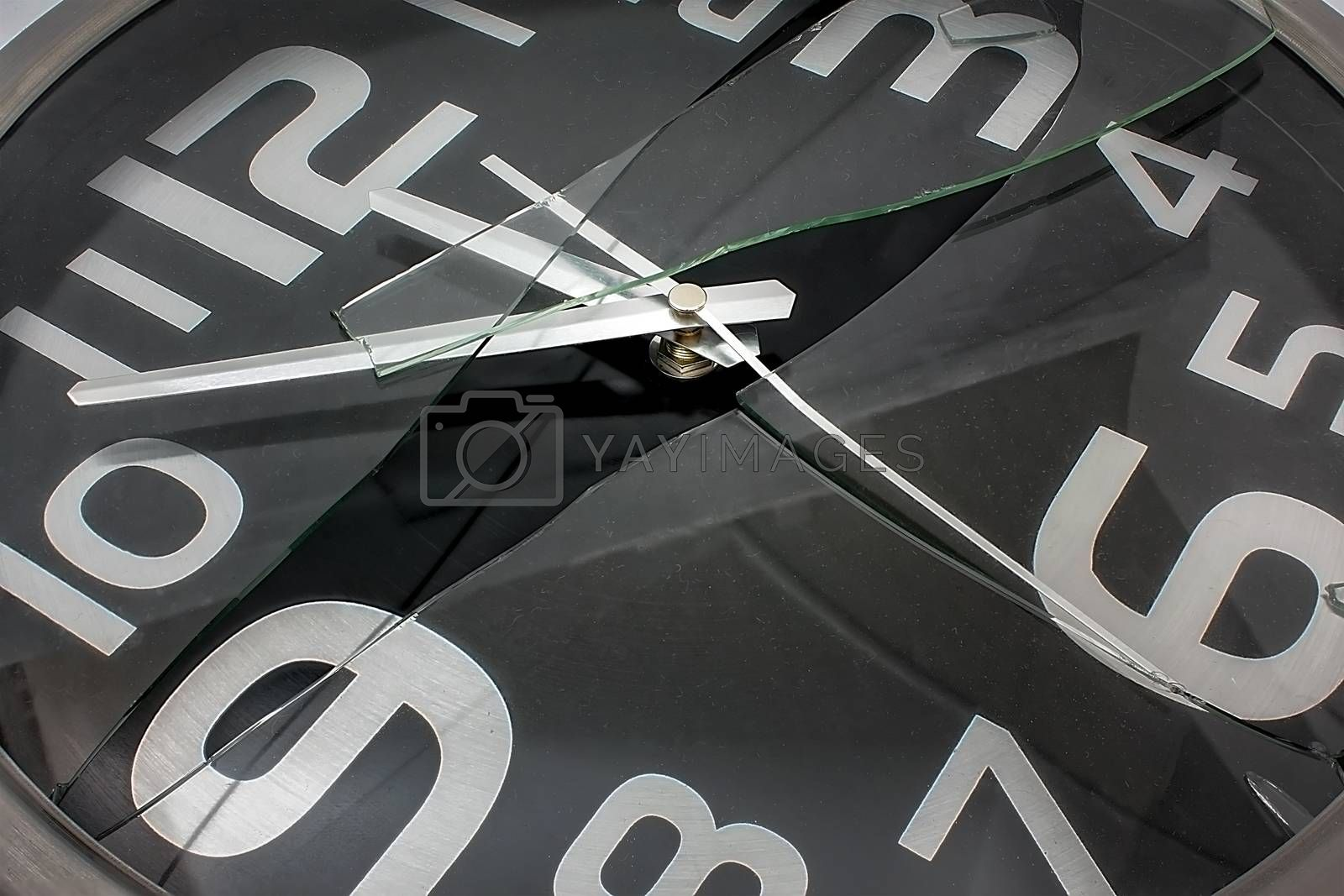 Black and Silver Wall Clock with Broken Glass