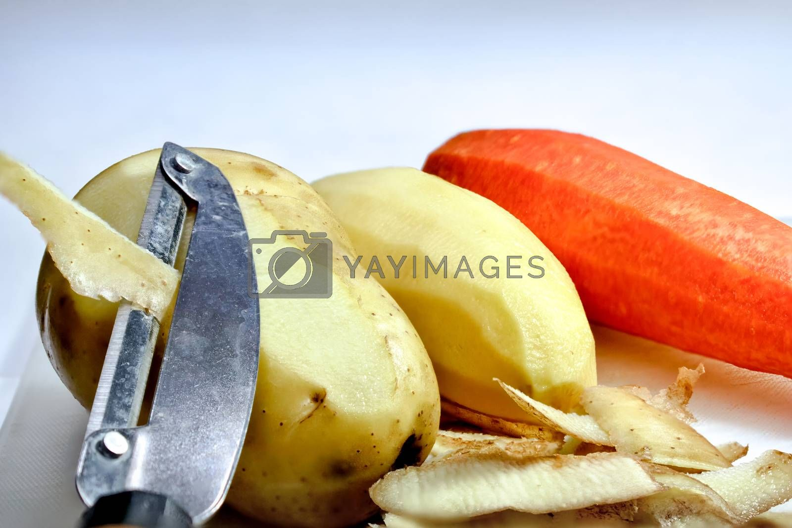 Peeled Potatoes and a Carrot during Preparation