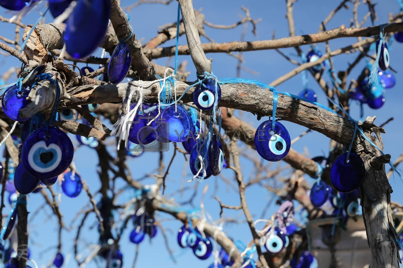 Evil Eye Beads Tree in Pigeons Valley, Cappadocia, Nevsehir, Tur by EvrenKalinbacak