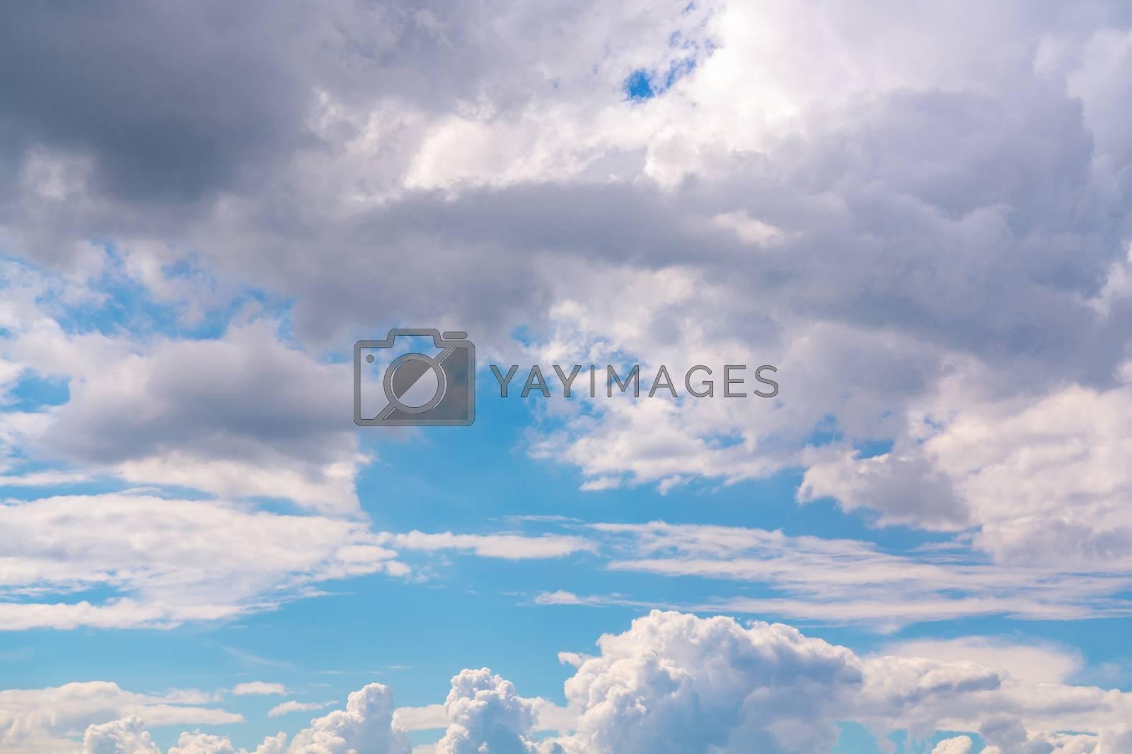 Beautiful cumulus clouds in a blue sky by galsand