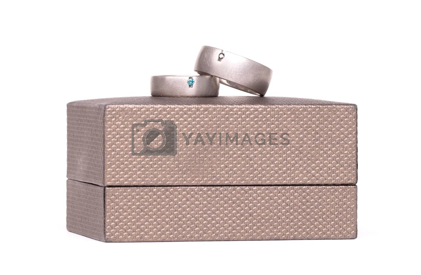 Wedding rings on box by michaklootwijk