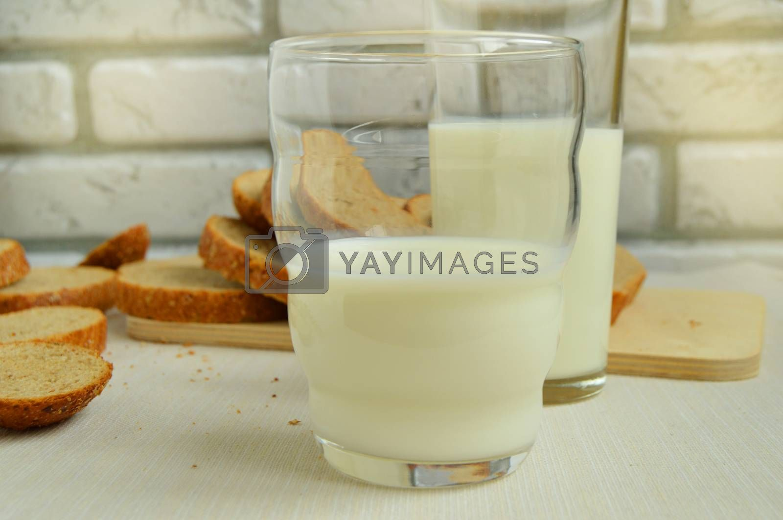 Two glasses of milk are on the table, Breakfast for the family, healthy eating concept, world health day by Claire Lucia