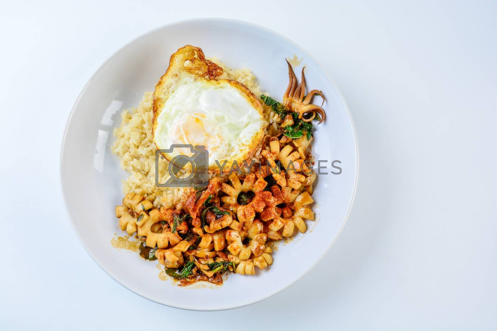 Spicy stir fried squid with basil leaves and chili, Sunny side u by YuiYuize