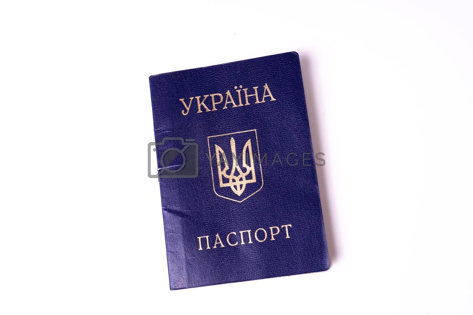 Blue Ukrainian passport isolated on white background. Passport is old and damaged a little bit. Stock photo of travel documents. by alexsdriver