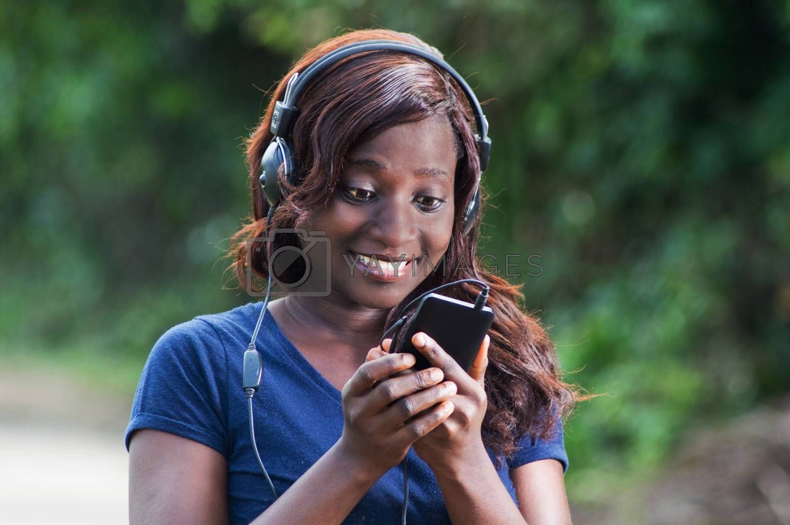 happy young woman with headphones. by vystekimages