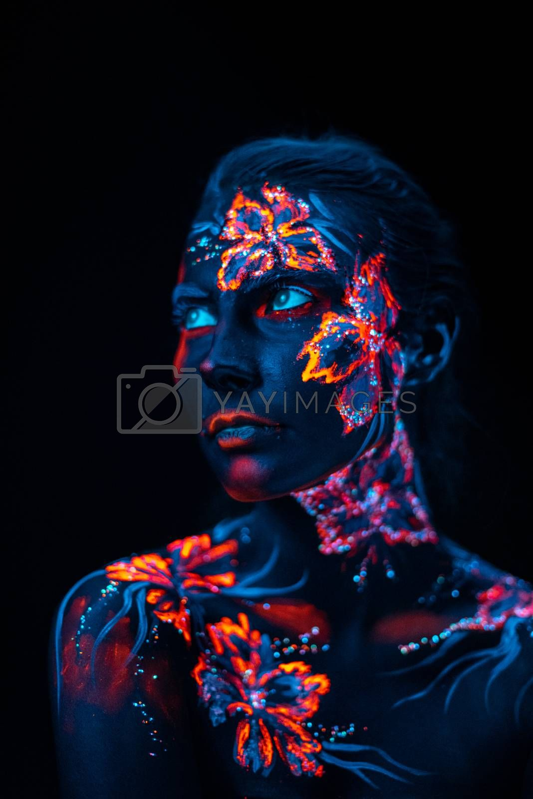Beautiful flowers in UV light on a young girl face and body by Sergii Zarev