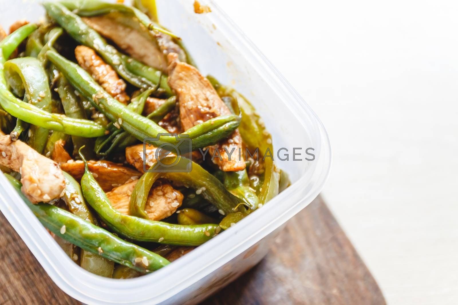 Chicken stew and green beans in plastic ovens for cold storage o by Tanacha