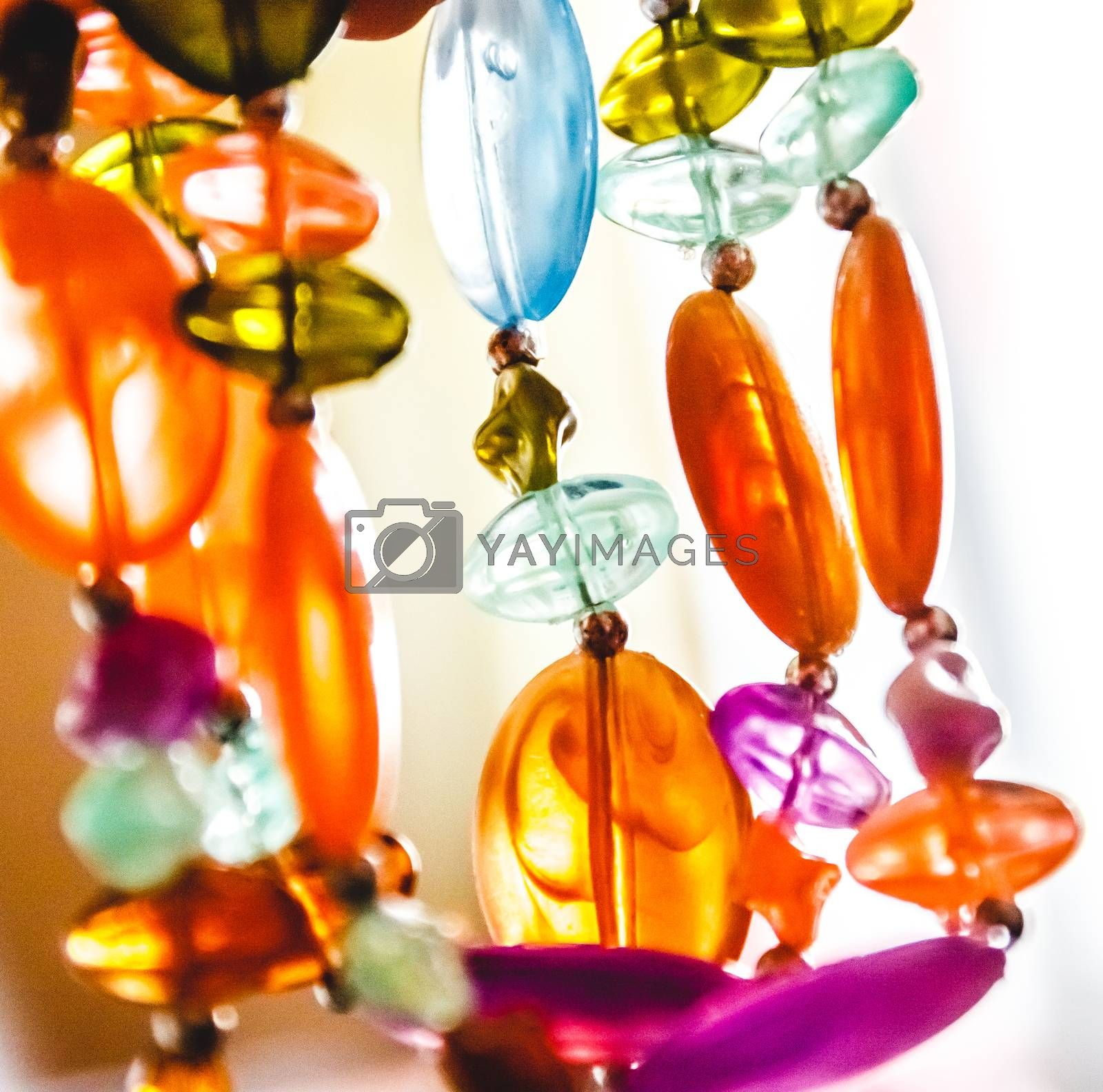 Bright multi-colored glass beads closeup. Blur and abstraction. by Tanacha