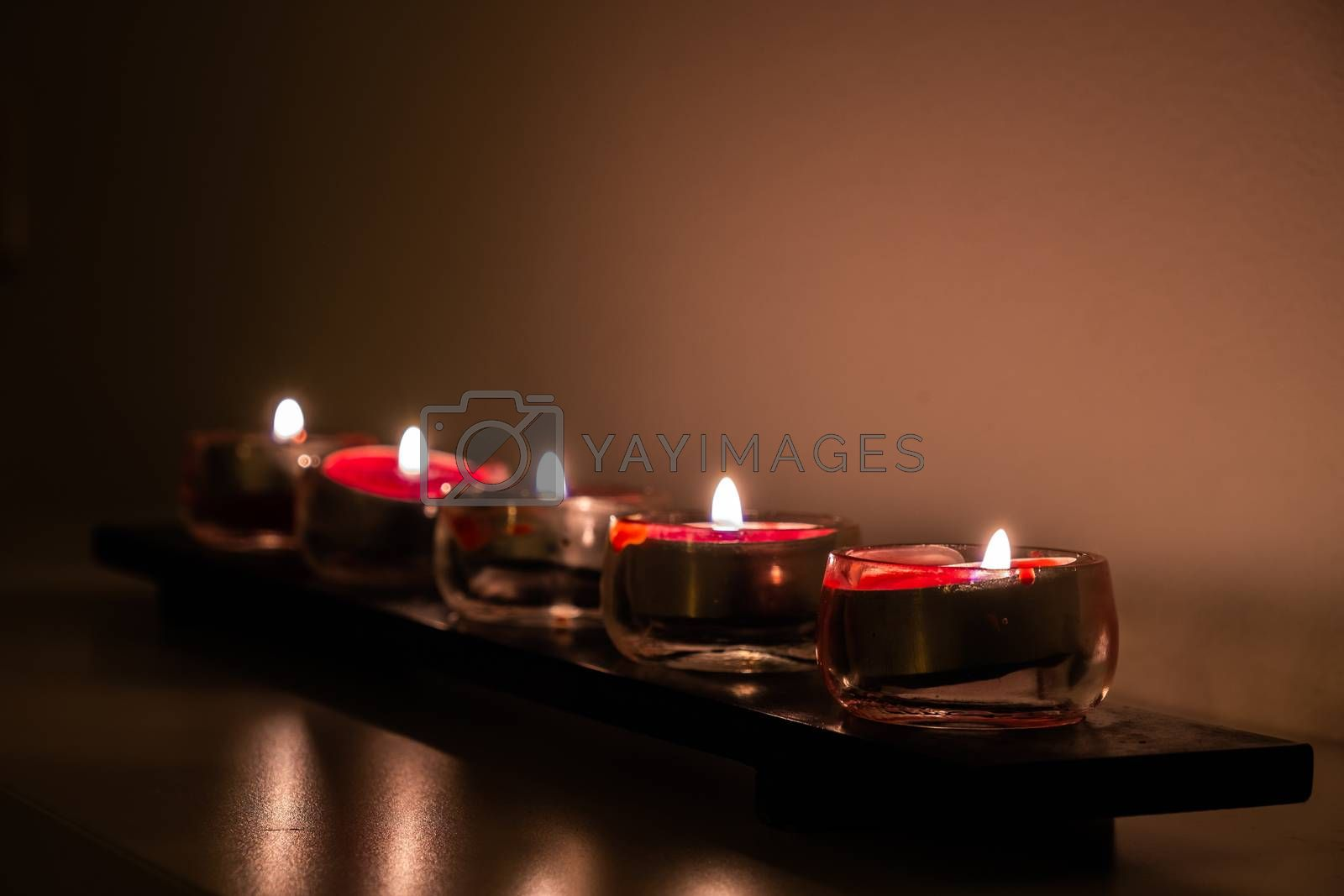 Royalty free image of A Roll of Lid Small Red Candles by kstphotography