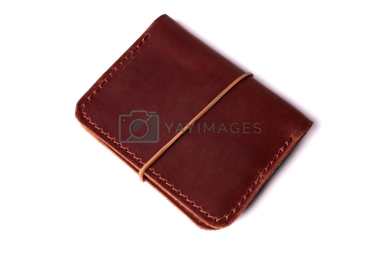 Handmade red color leather cardholder with rubber band isolated  by alexsdriver