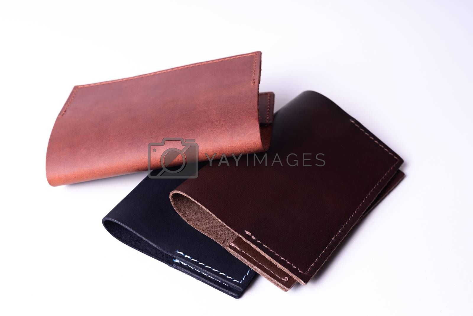 Three handmade leather passport covers isolated on white backgro by alexsdriver