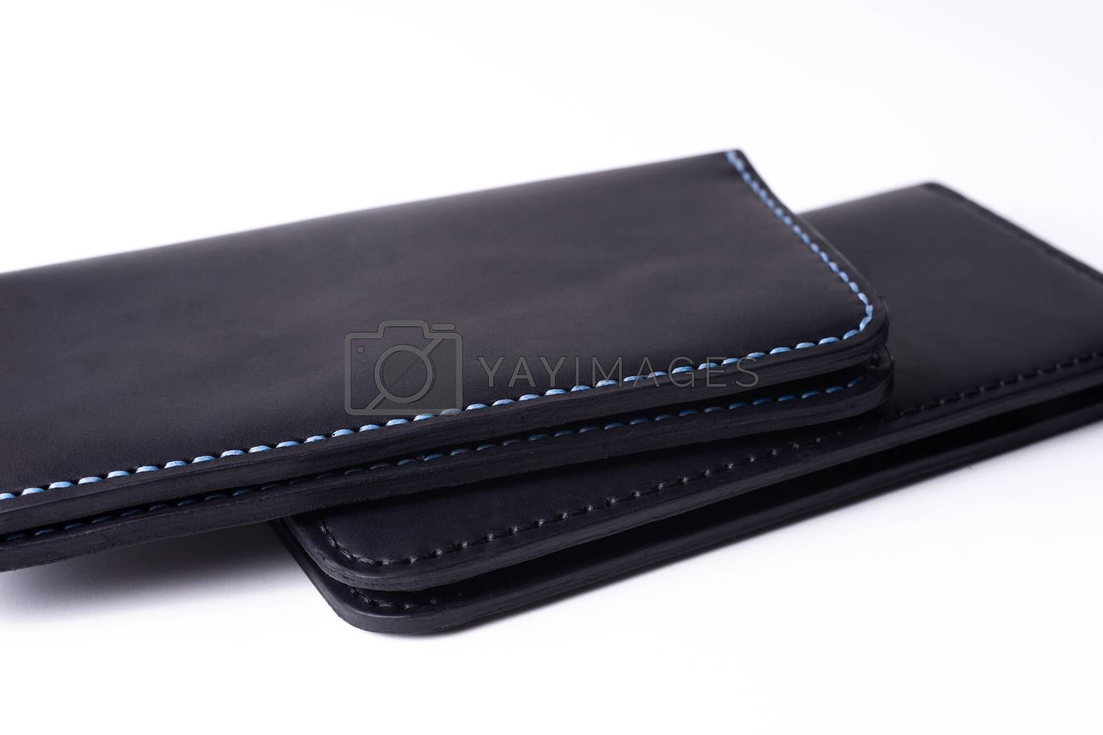 Two handmade leather black purse isolated on white background. S by alexsdriver