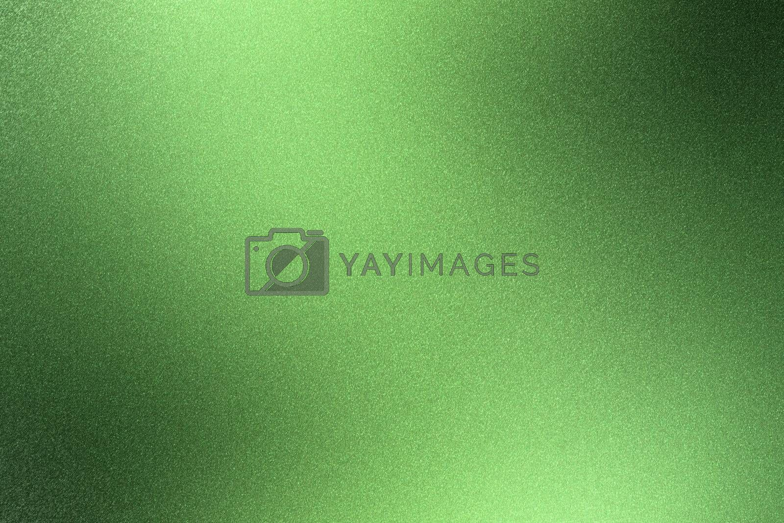 Glowing rough green metal wall surface, abstract texture background by mouu007
